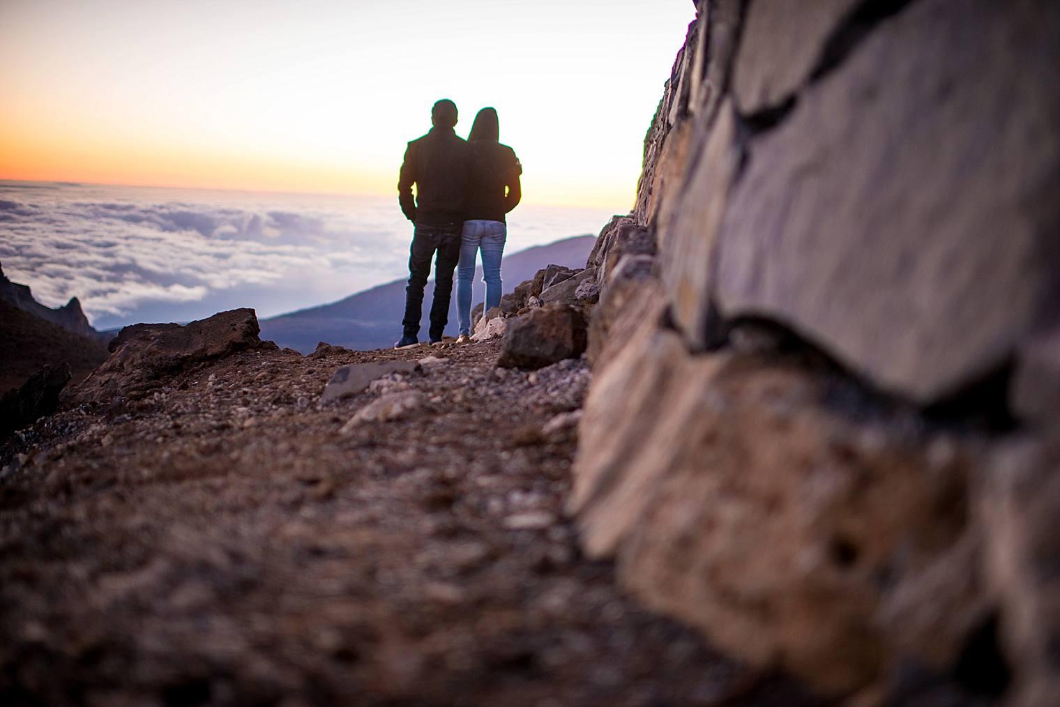 couple looking over haleakala crater in maui, hawaii