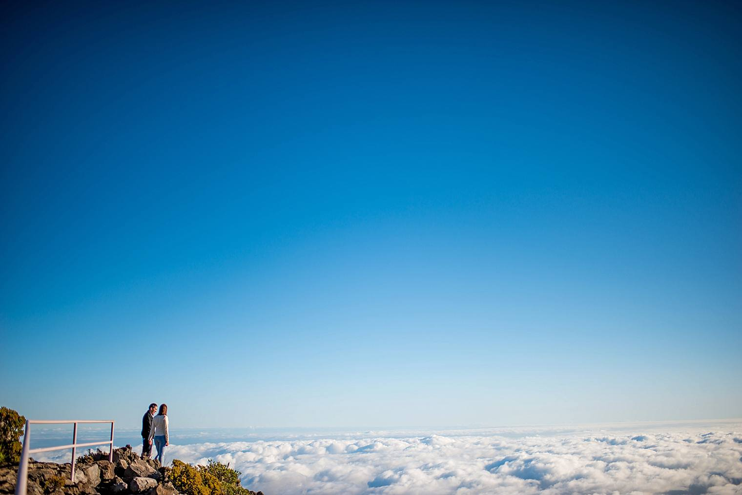 Couple standing on top of mountain in Maui