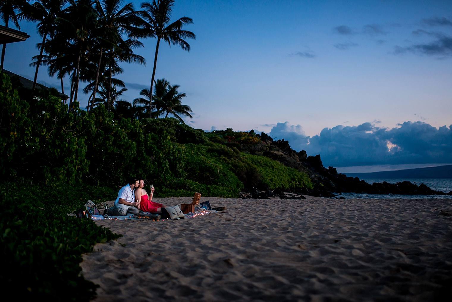 engaged couple enjoying sunset on the beach