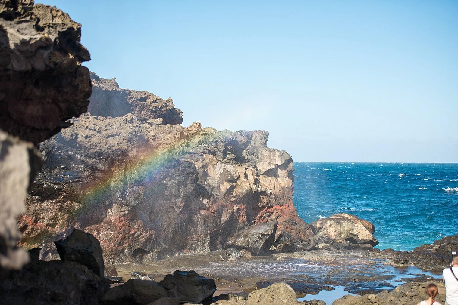rainbow at blowhole in Maui, hawaii