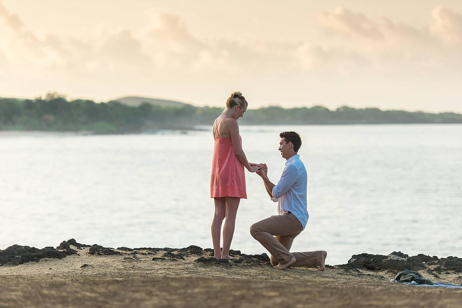 man proposing at sunrise in maui