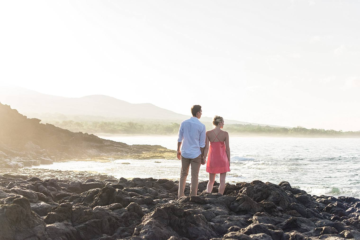 newly engaged couple on lava rocks
