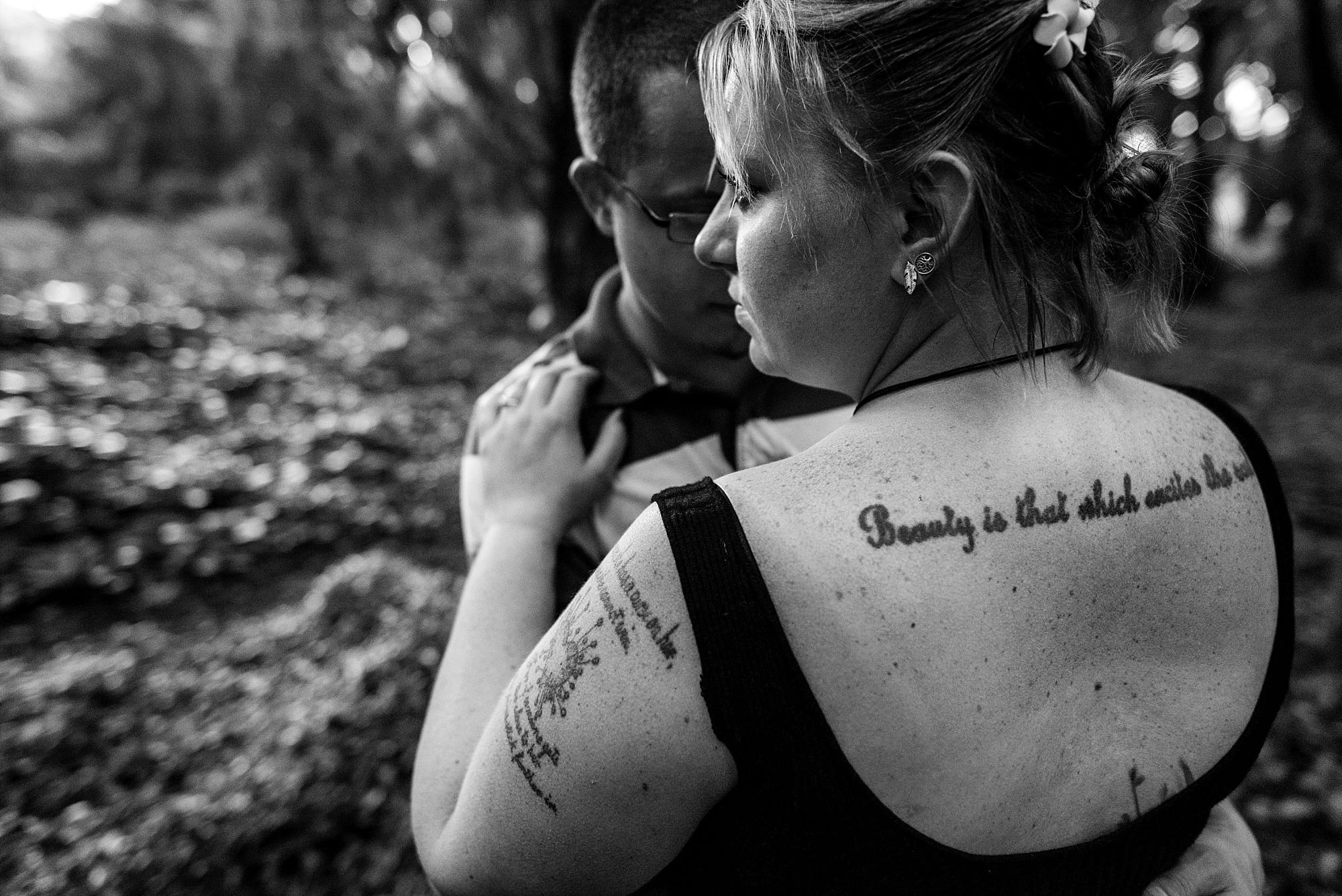 snuggling new fiances, back tattoo