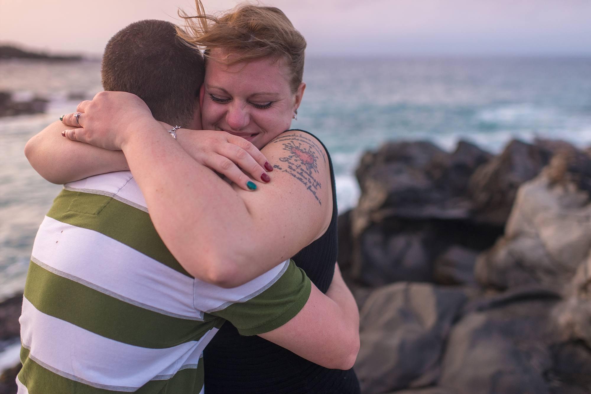 overjoyed woman hugging her fiance