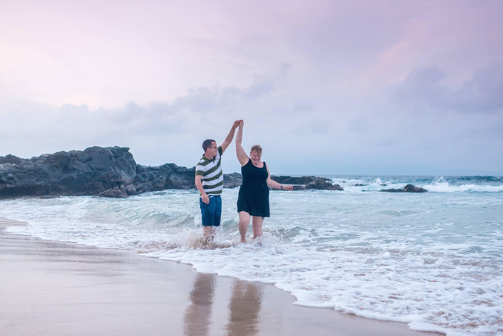 couple dancing in the ocean