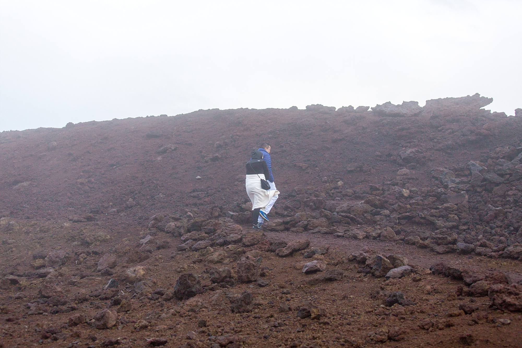 couple walking up Haleakala