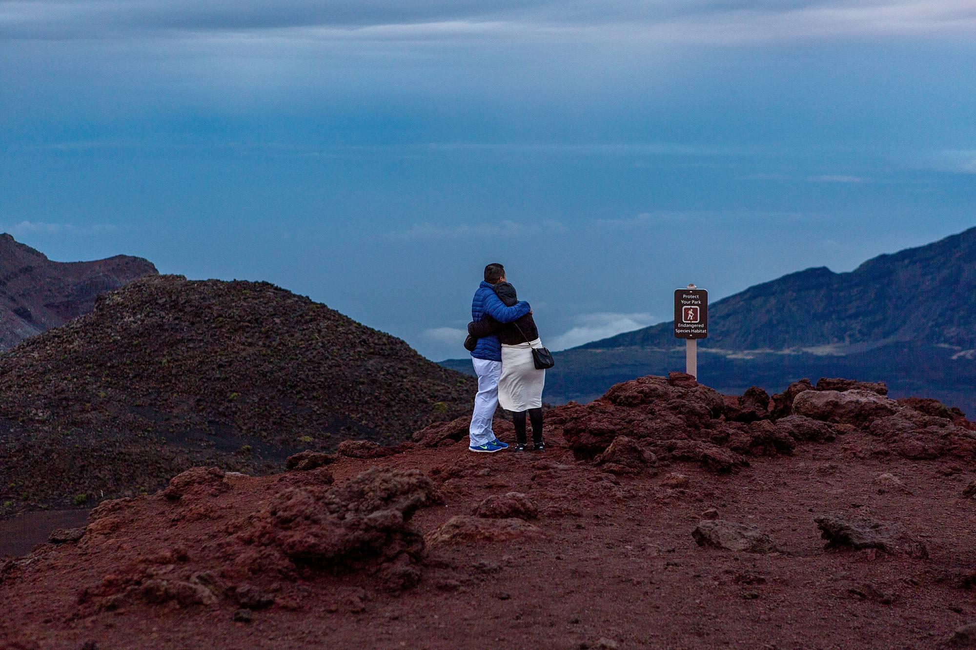 couple hugging on mountain