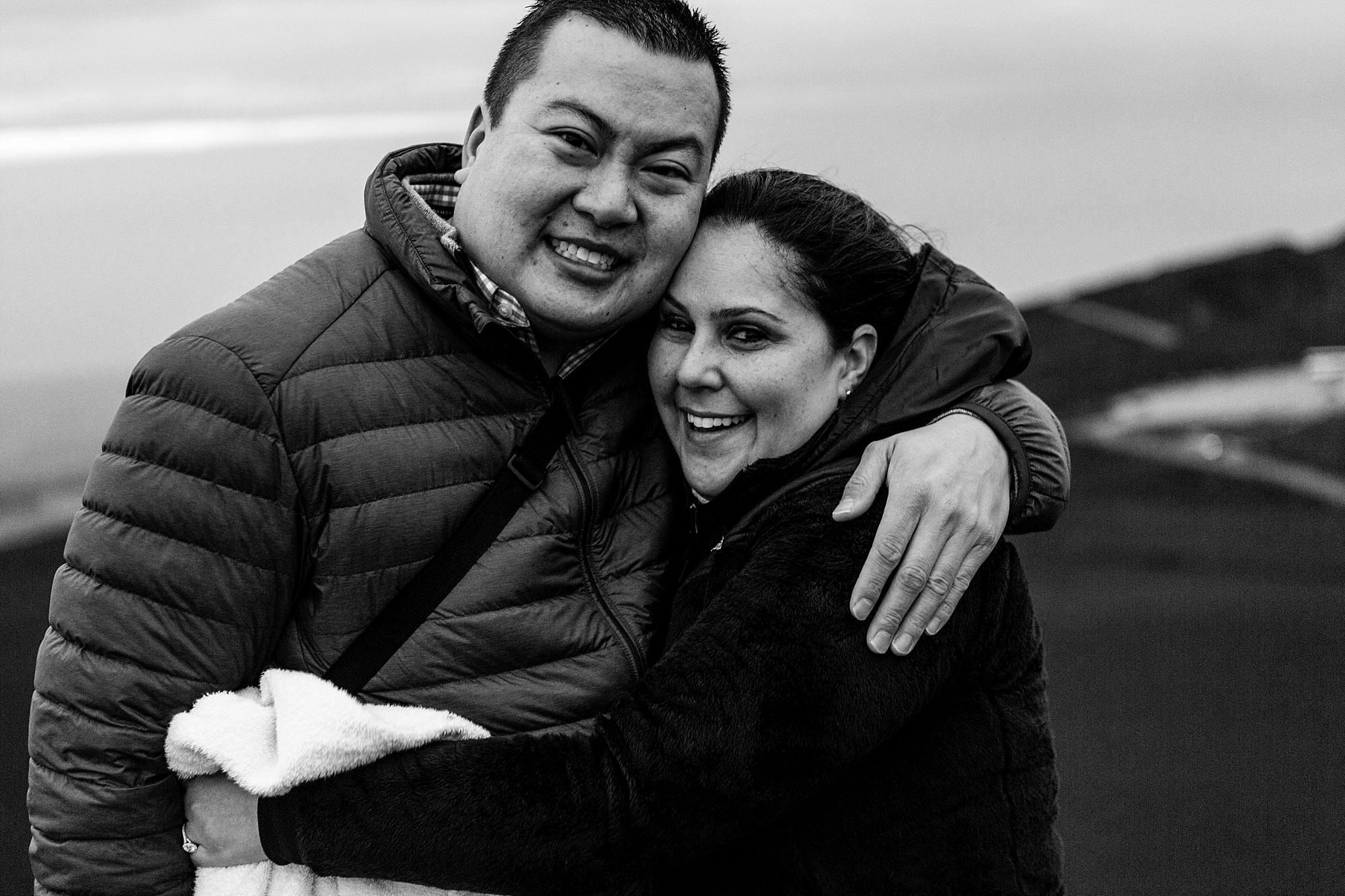 black and white image of newly engaged couple