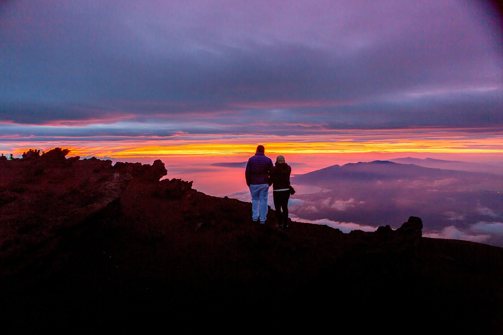 couple standing side by side after their sunset proposal on Haleakala