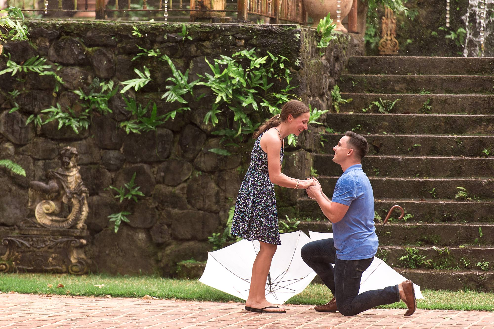 man down on one knee proposing to girlfriend