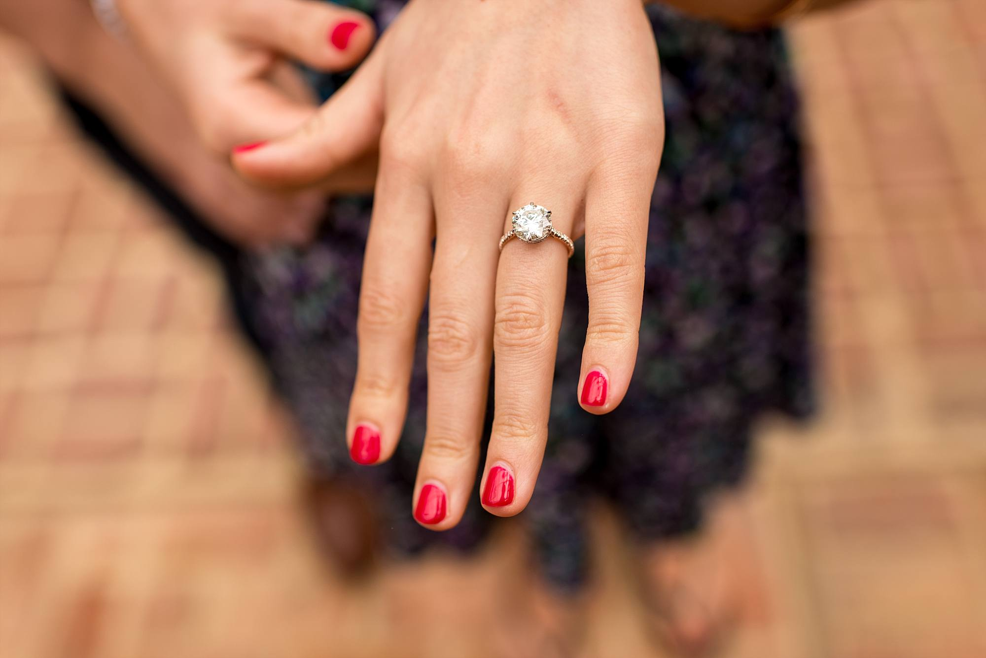 woman's hand with brand new engagement ring