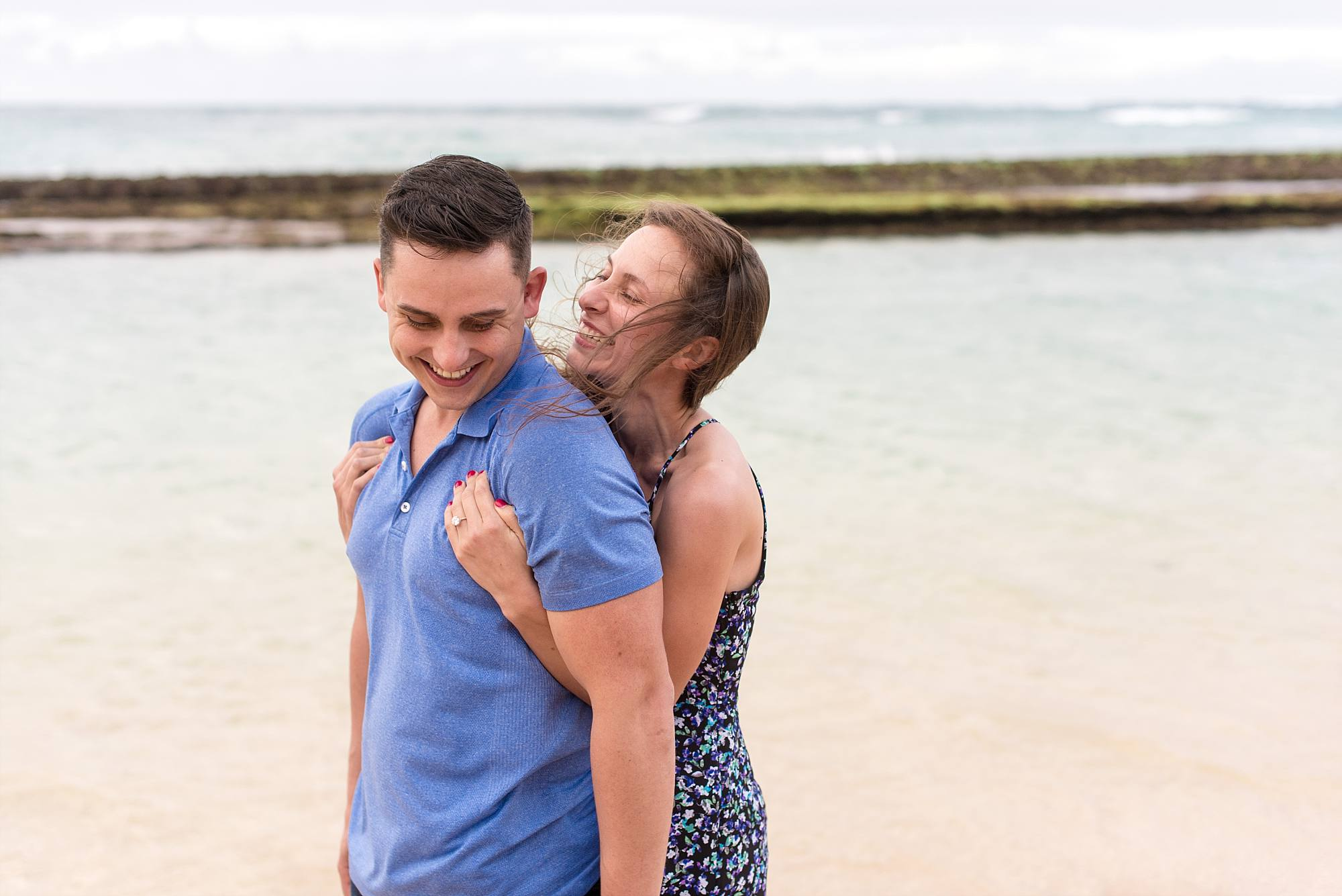 woman wrapping her arms around her man