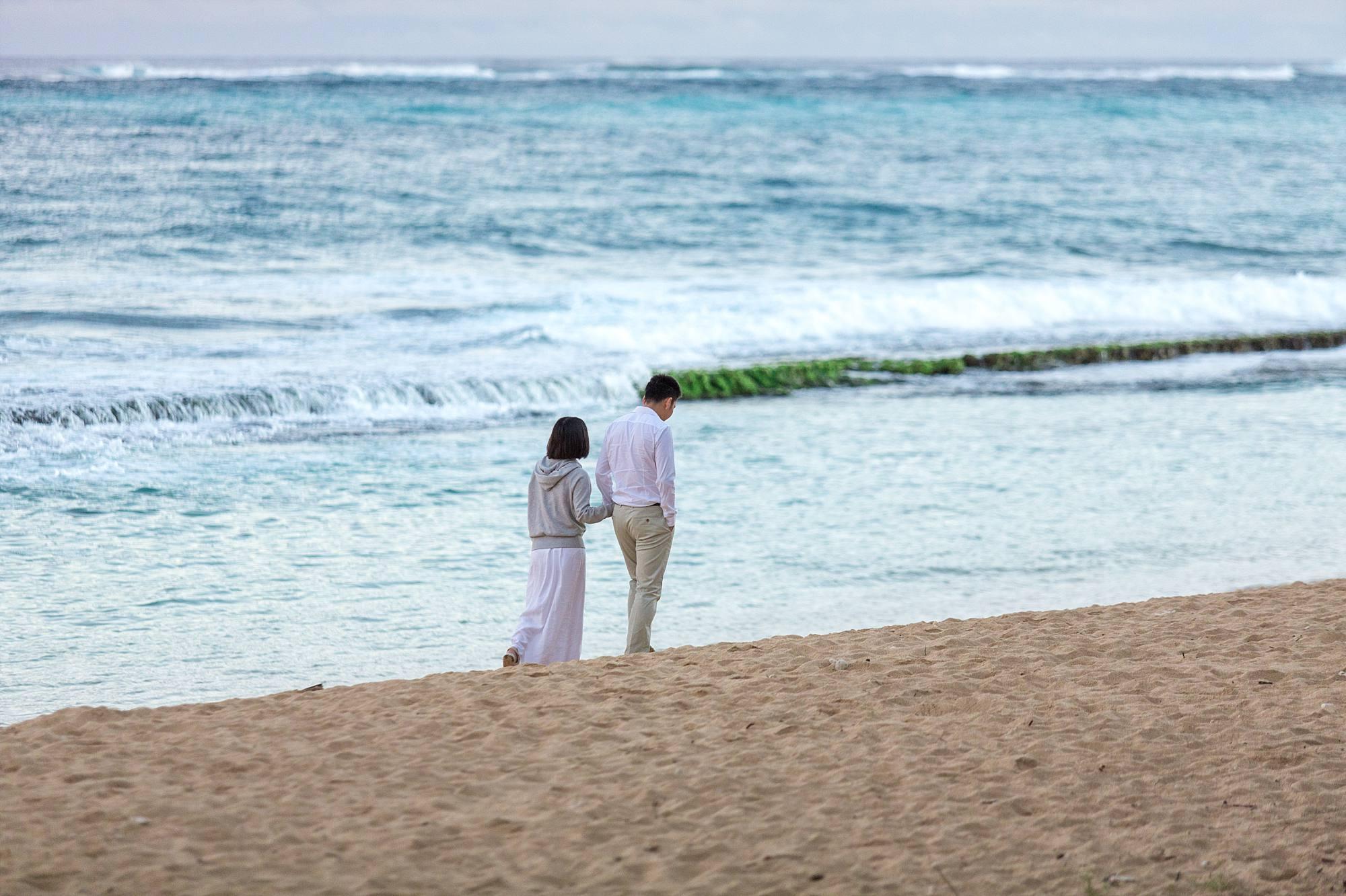 Couple strolling on beach
