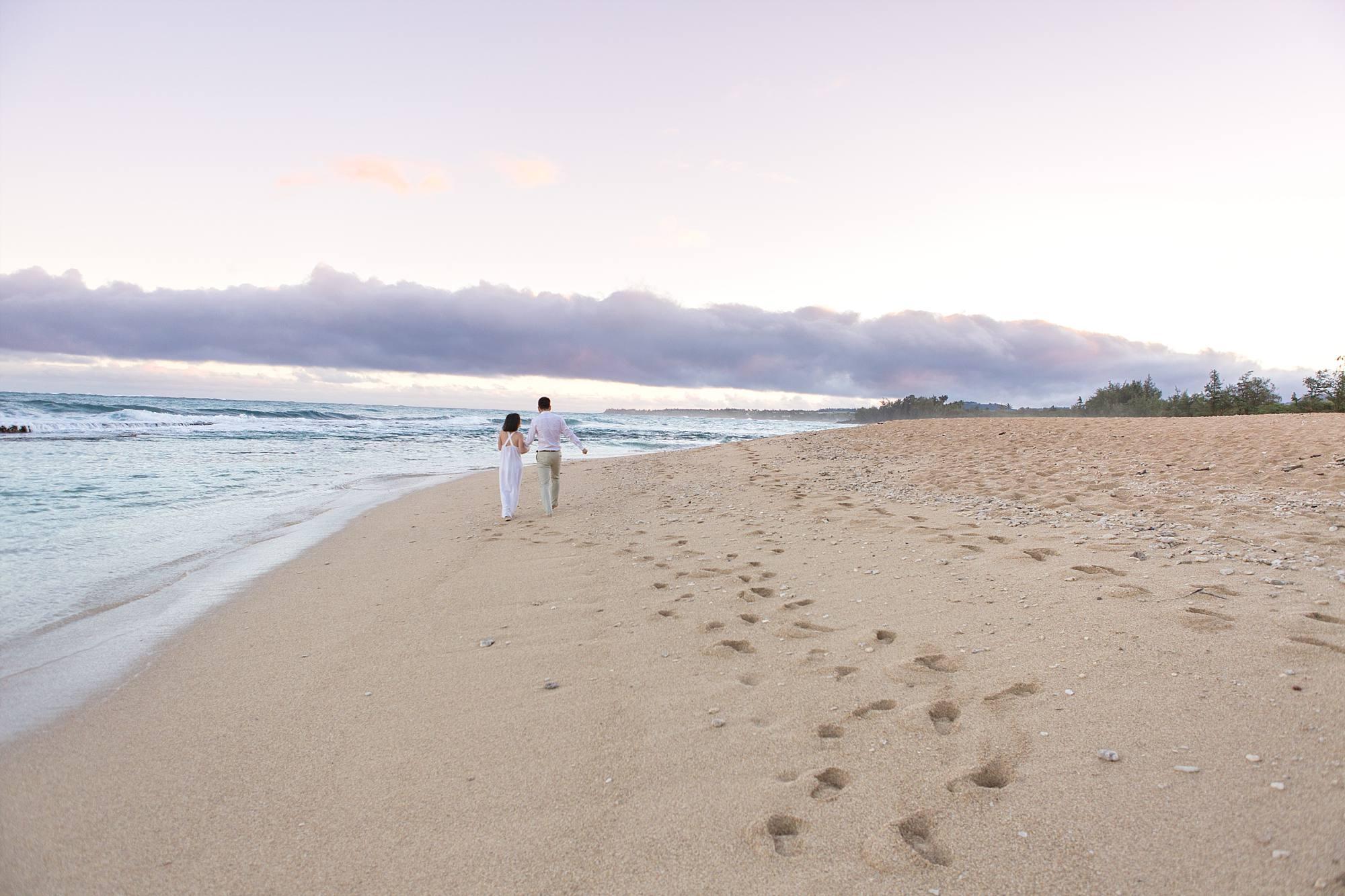 couple on romantic walk down the beach