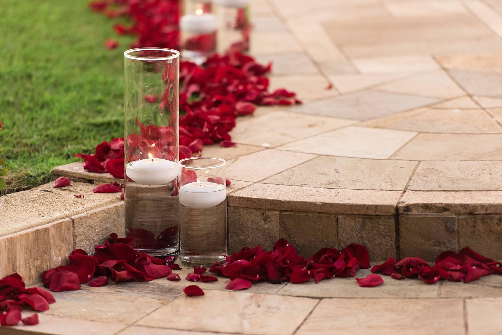 Candles adn flower petals on walkway
