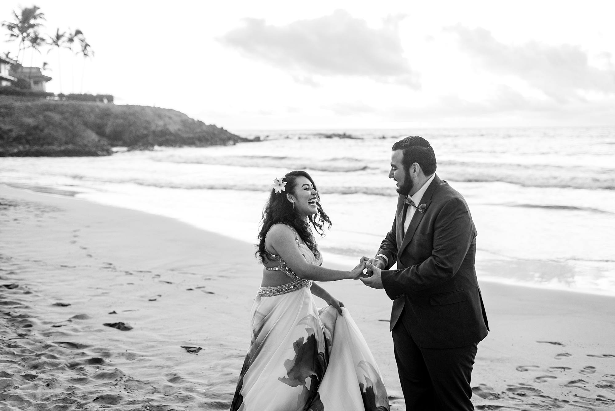 bride- and groom-to-be dancing on beach