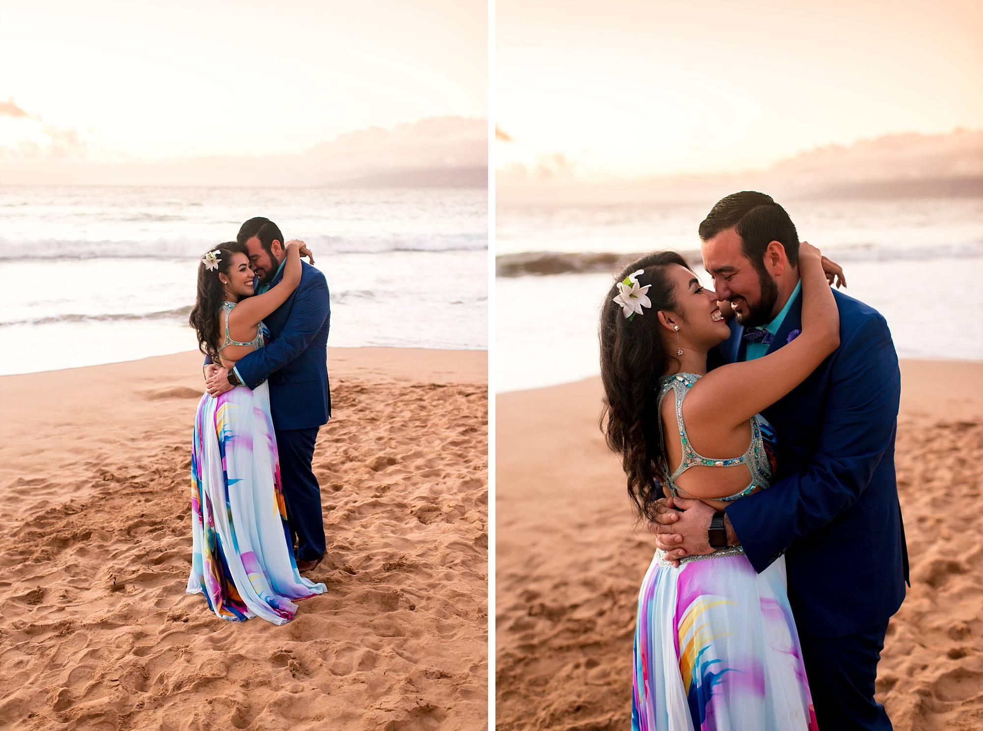 newly engaged couple cuddling on beach