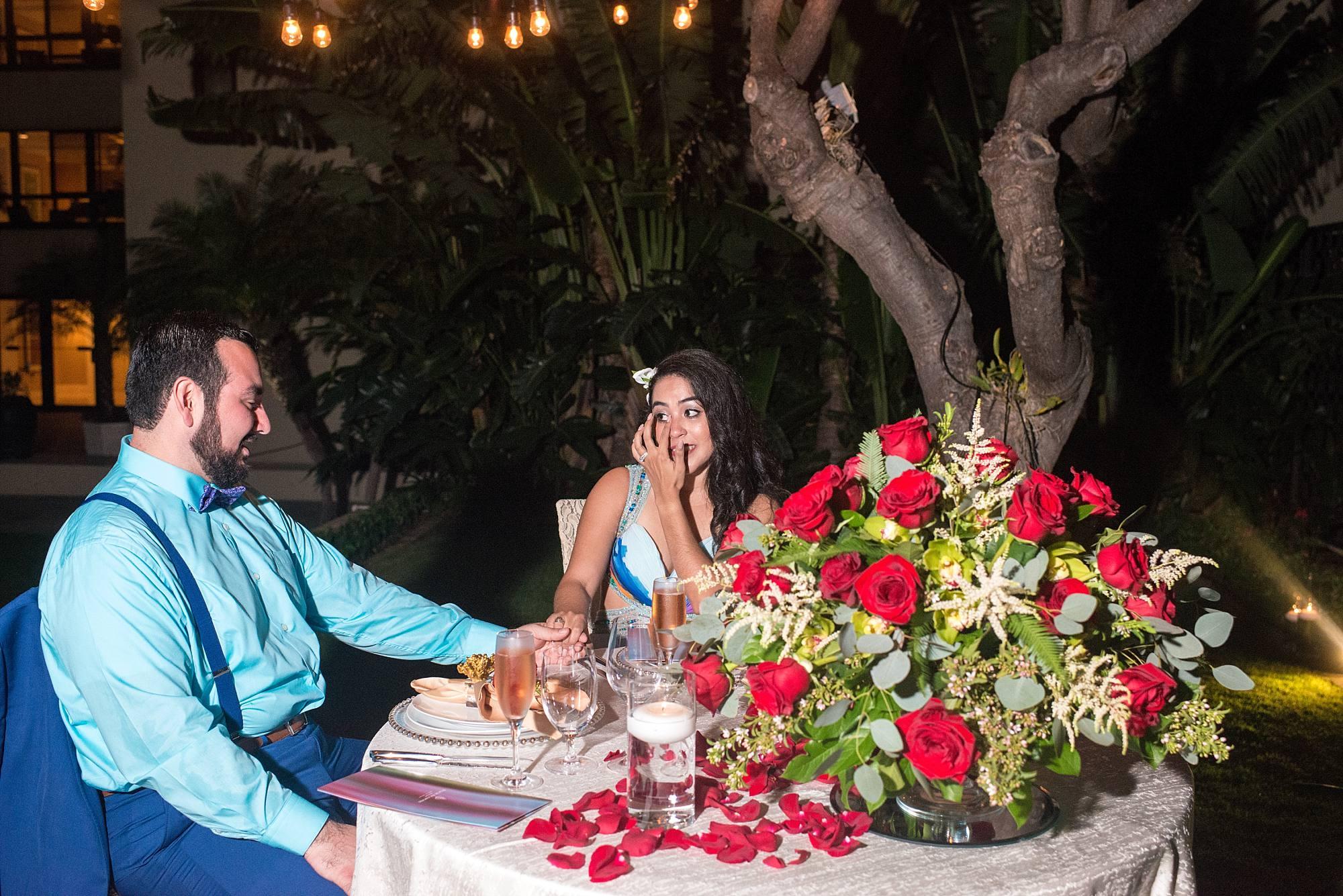 Intimate dinner between fiances, huge flower arrangment