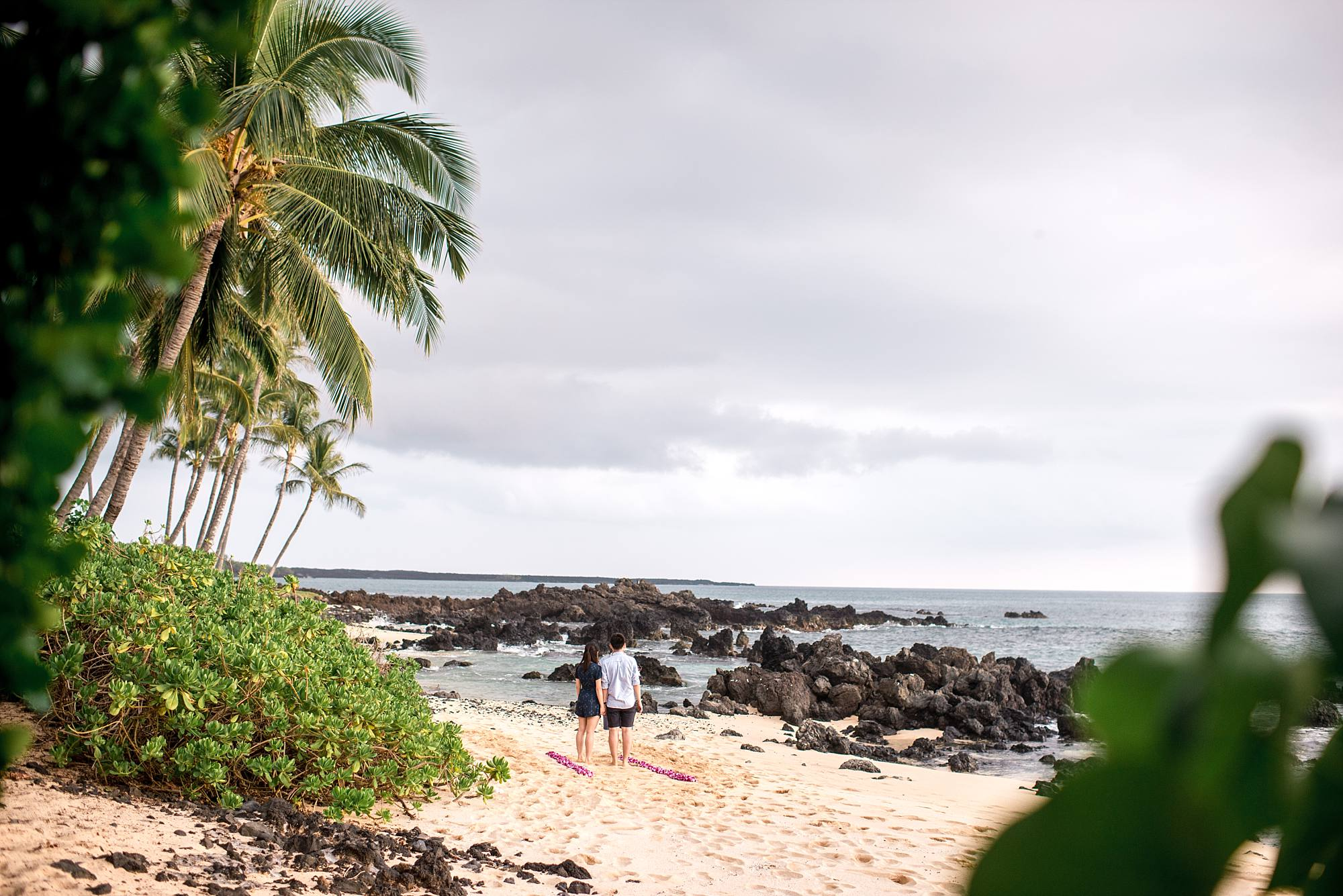 South Maui beach with couple holding hands being serenaded by Ukulele player