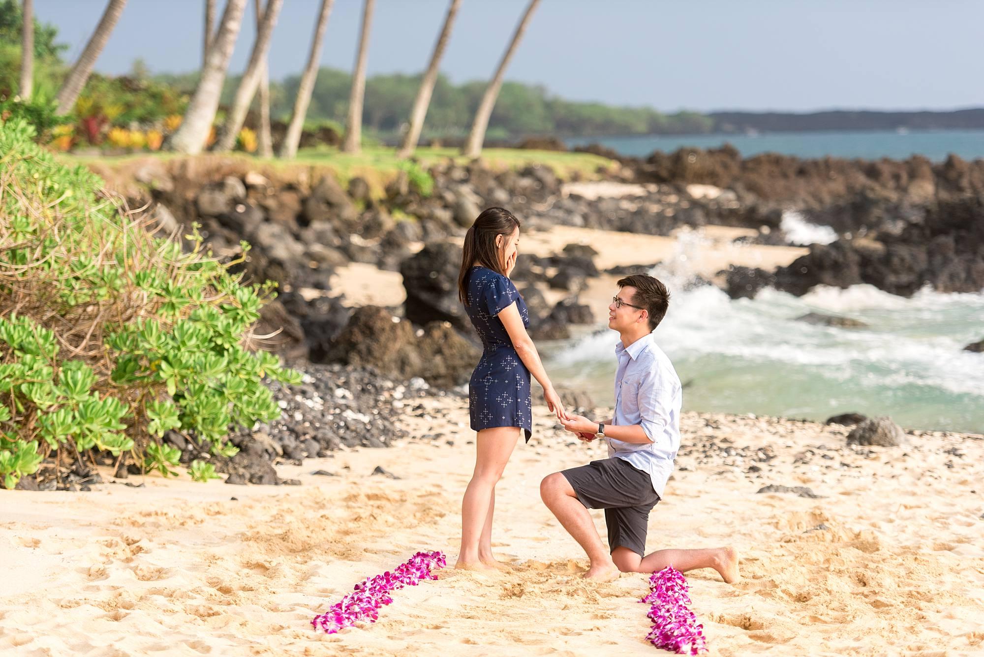 man proposing to girlfriend on gorgeous maui beach