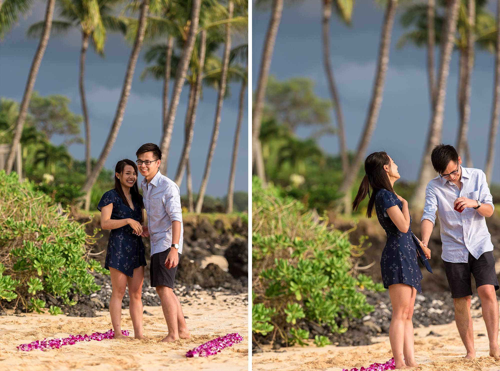 newly engaged couple standing together on a beach, her laughing in surprise as he points out the photographer