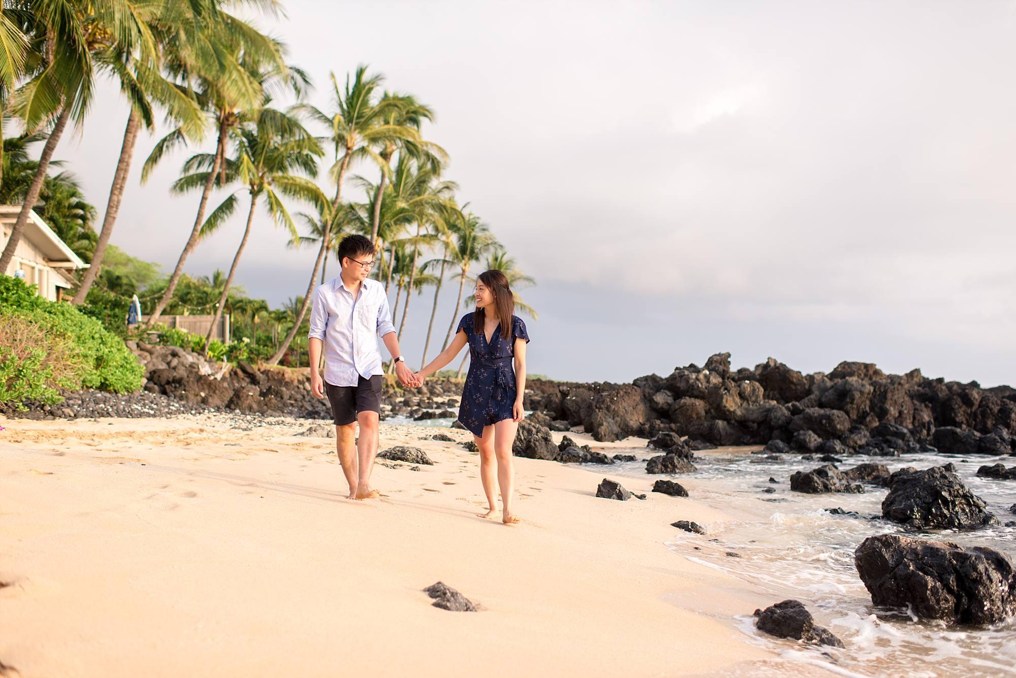 fiances walking hand in hand down south Maui beach