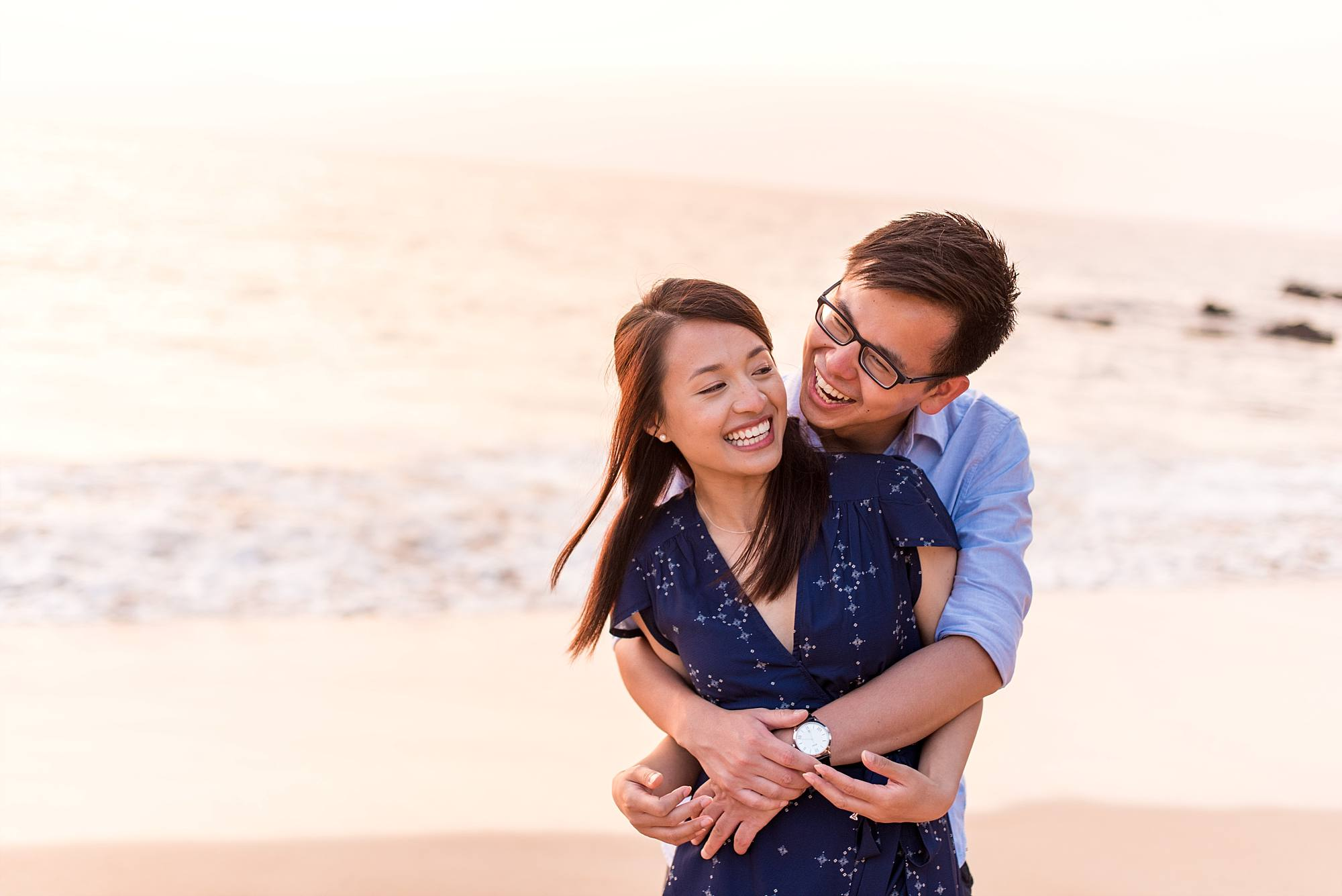 engagement photo of couple hugging on Maui beach