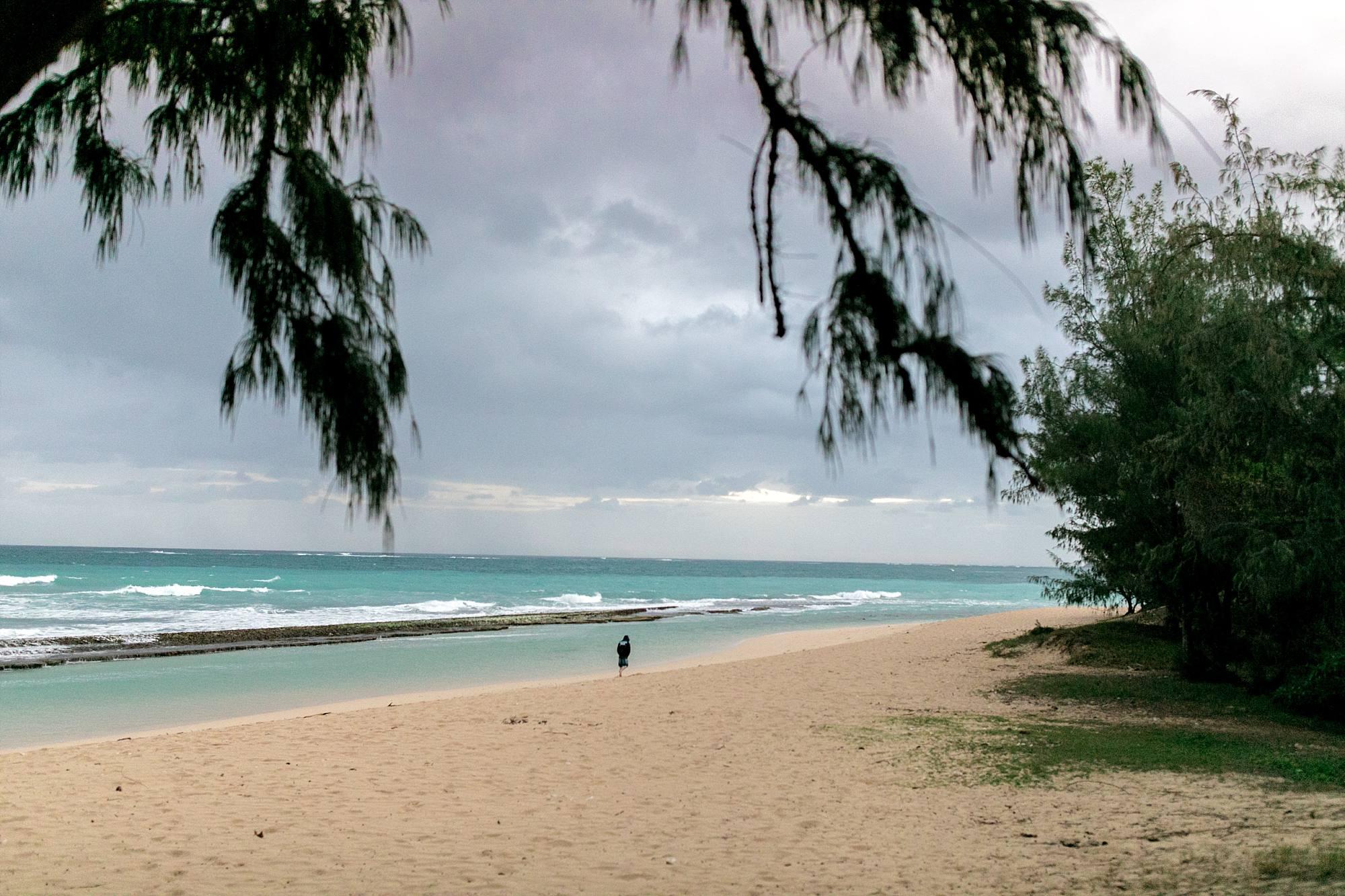 lovers walking down a Maui beach at sunrise