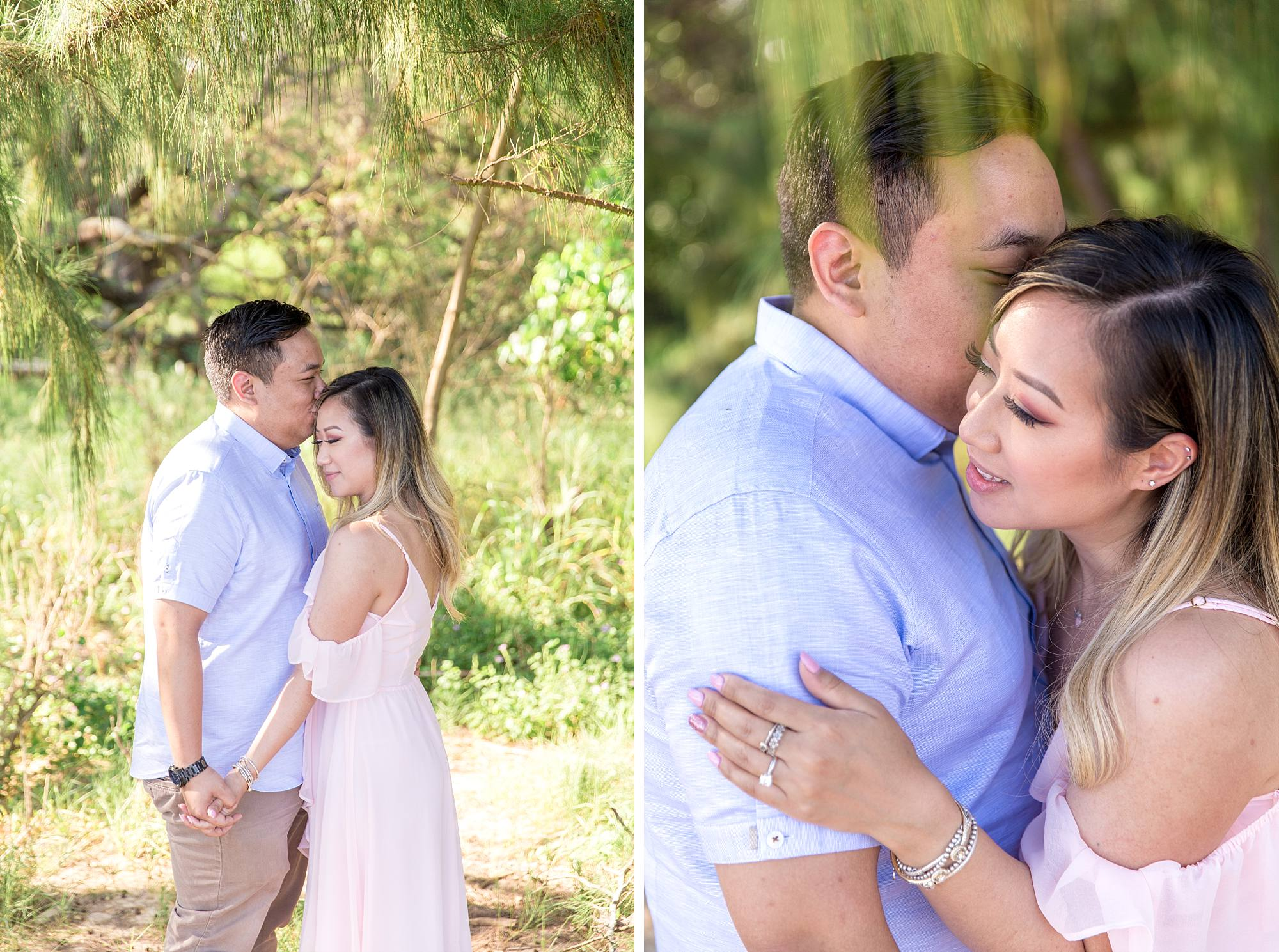 fiance kissing his lady's cheek sweetly in front of greenery