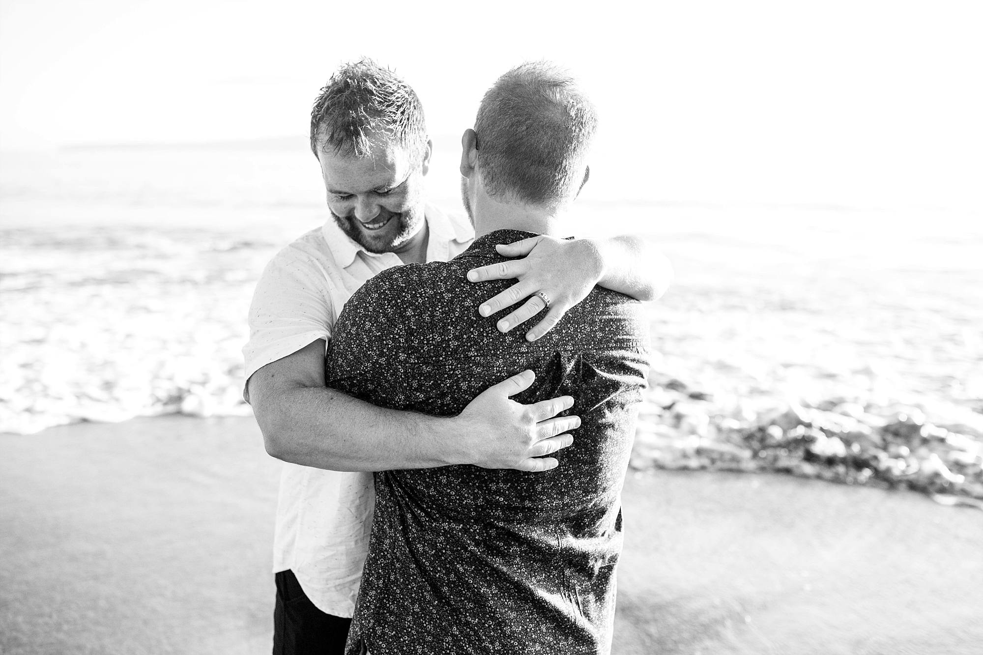 couple hugging just after engagement, black and white