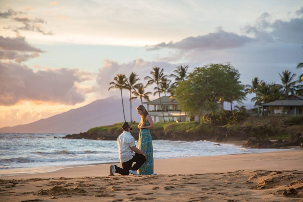 man proposing in Wailea Maui on beautiful beach
