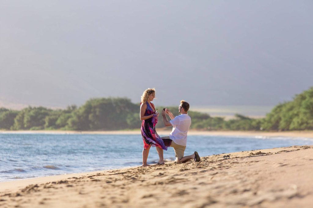 beach proposal in Maalaea, man down on one knee proposing to his love on a beautiful Maui beach