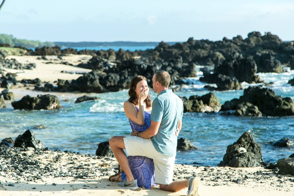 MAN DOWN On one knee proposing, and his girlfriend kneeling right along side him