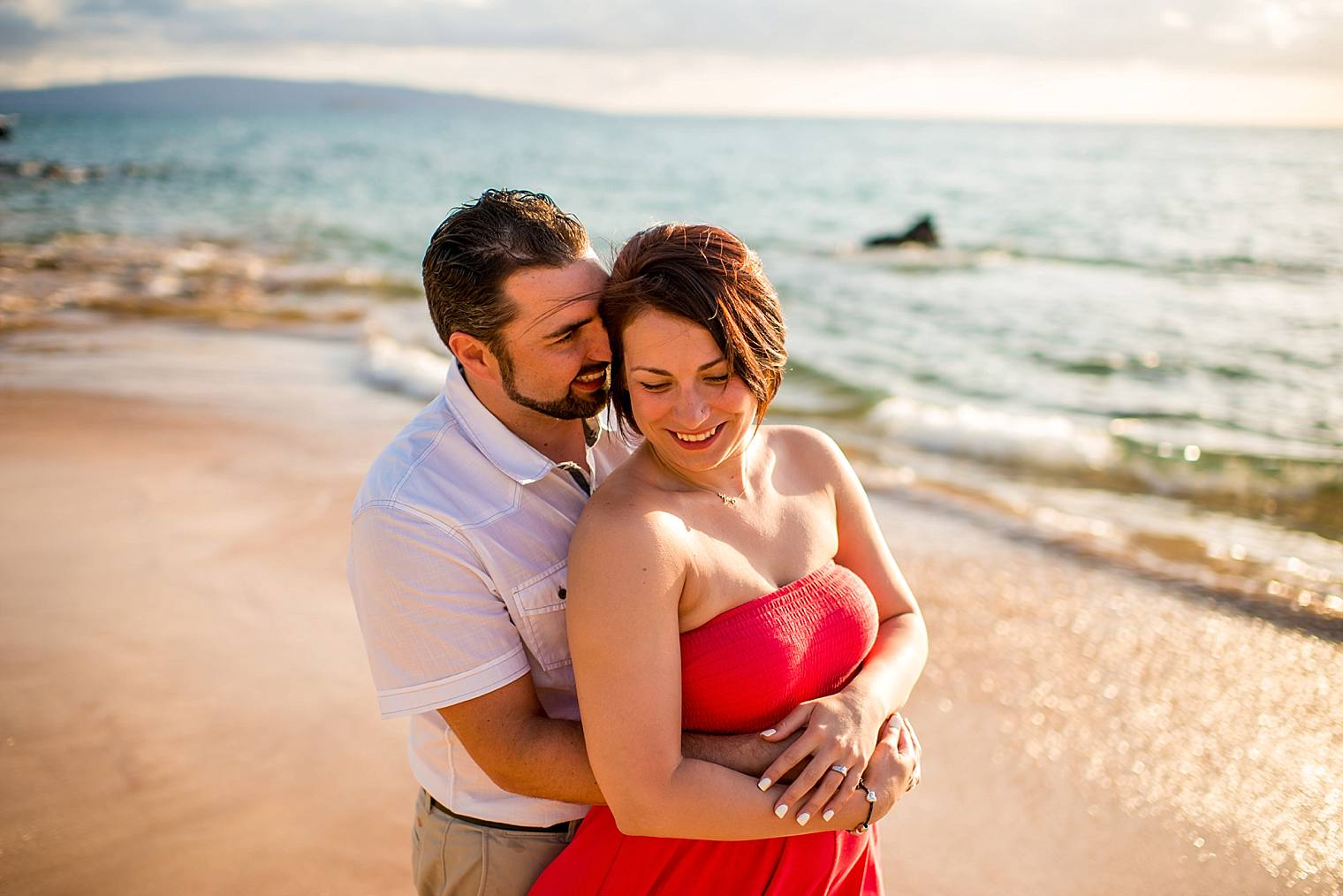 engaged couple on a beach in maui