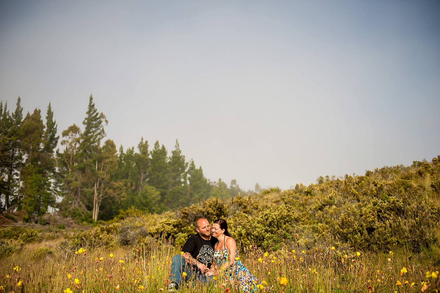 engagement photos in field of flowers upcountry maui