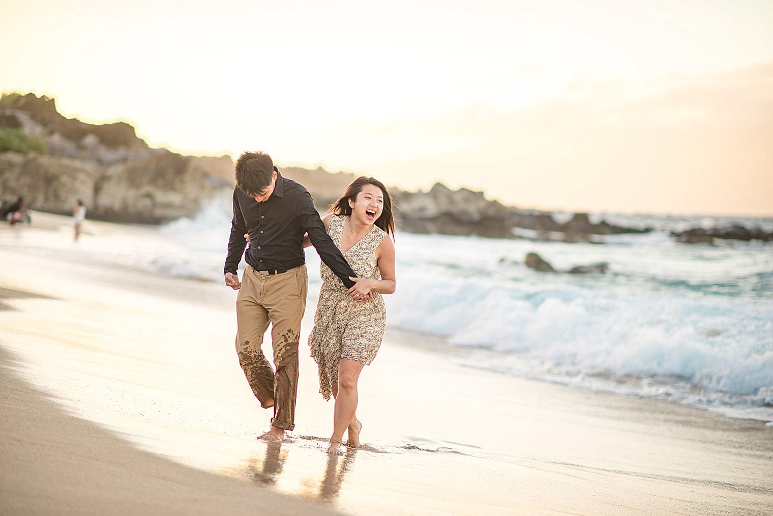 couple on the beach together in maui, hawaii
