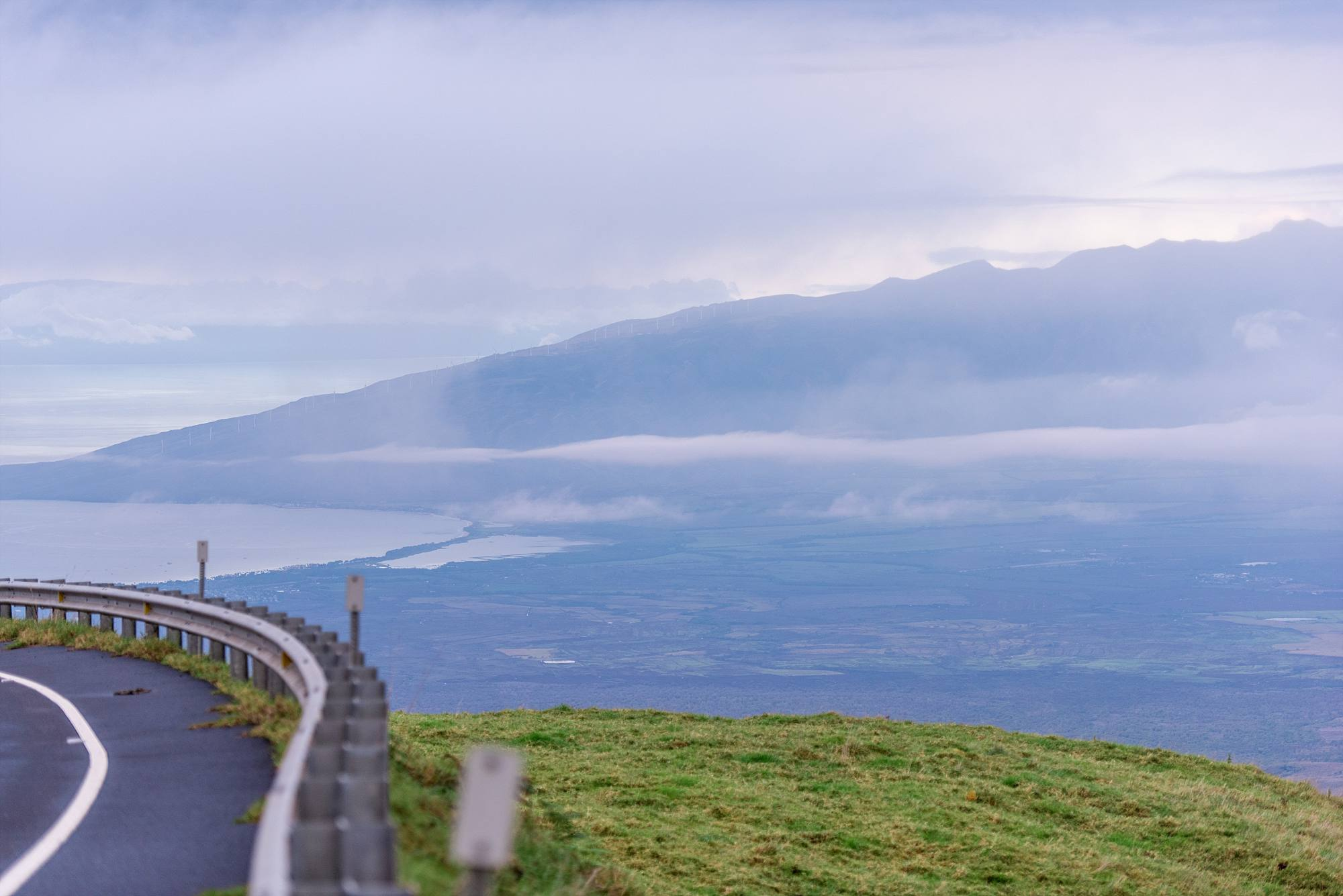 side of road with hills of Haleakala looking down on the Pacific