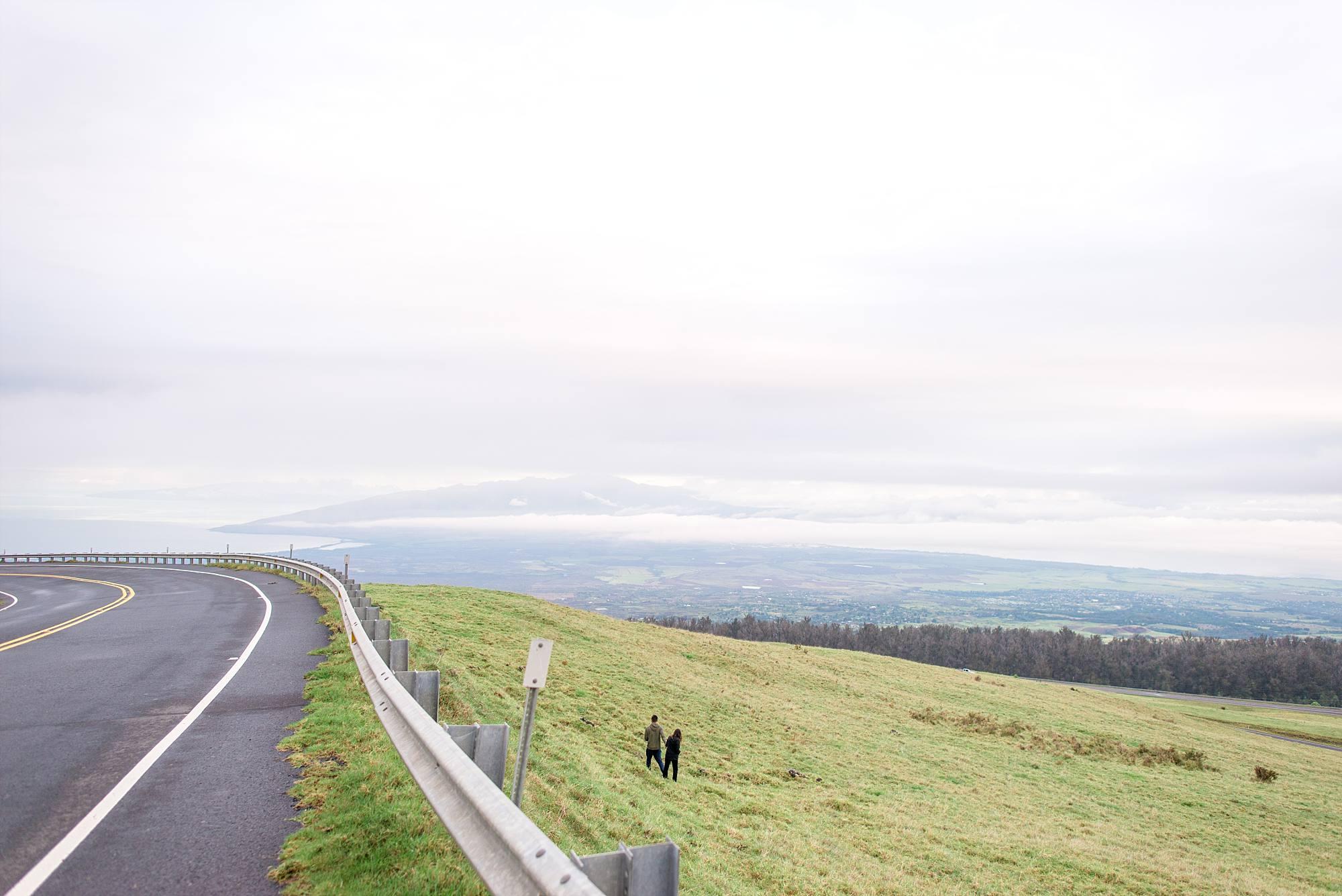 Road and hillside of Haleakala couple walking down
