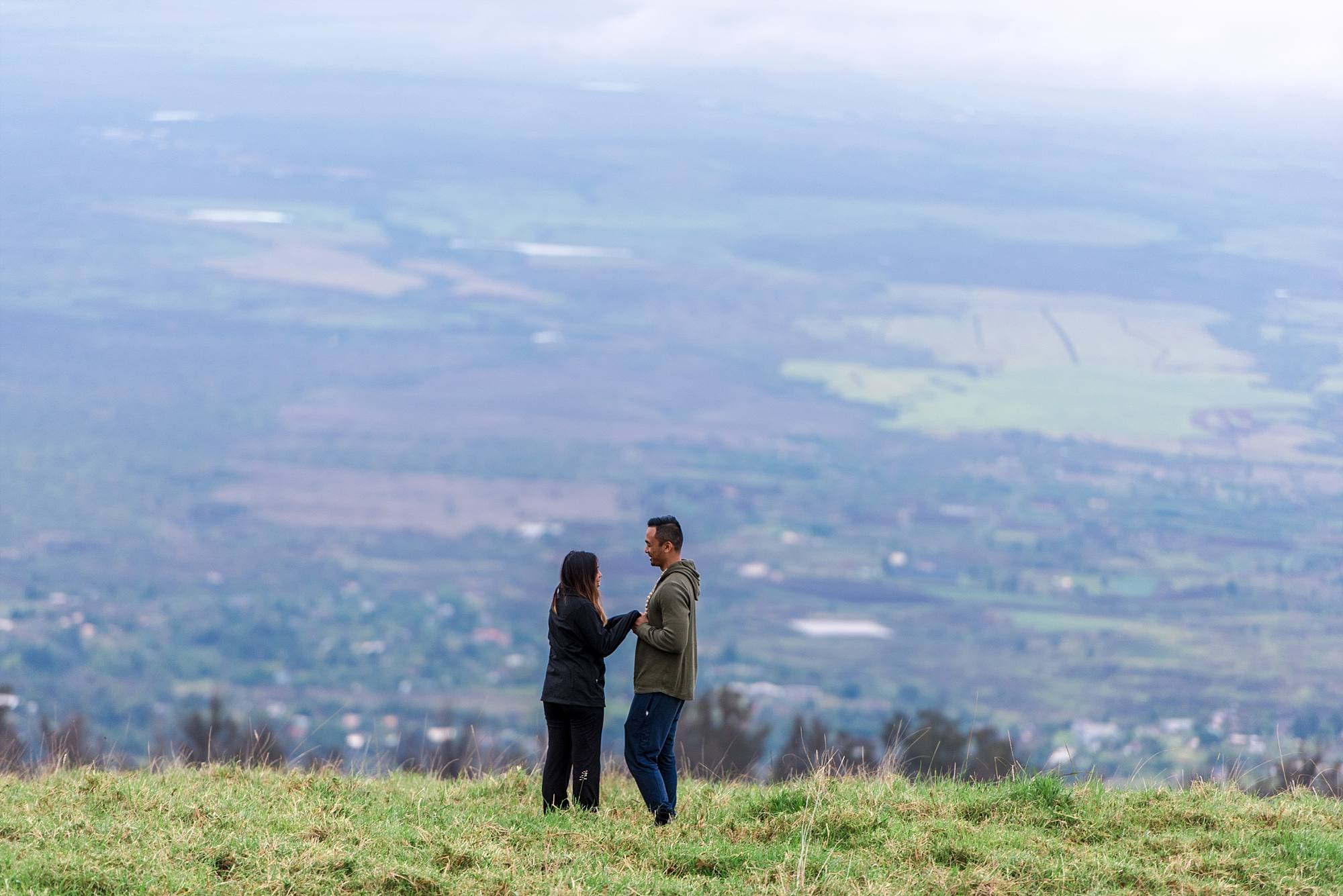 happy couple standing overlooking the valley in Maui