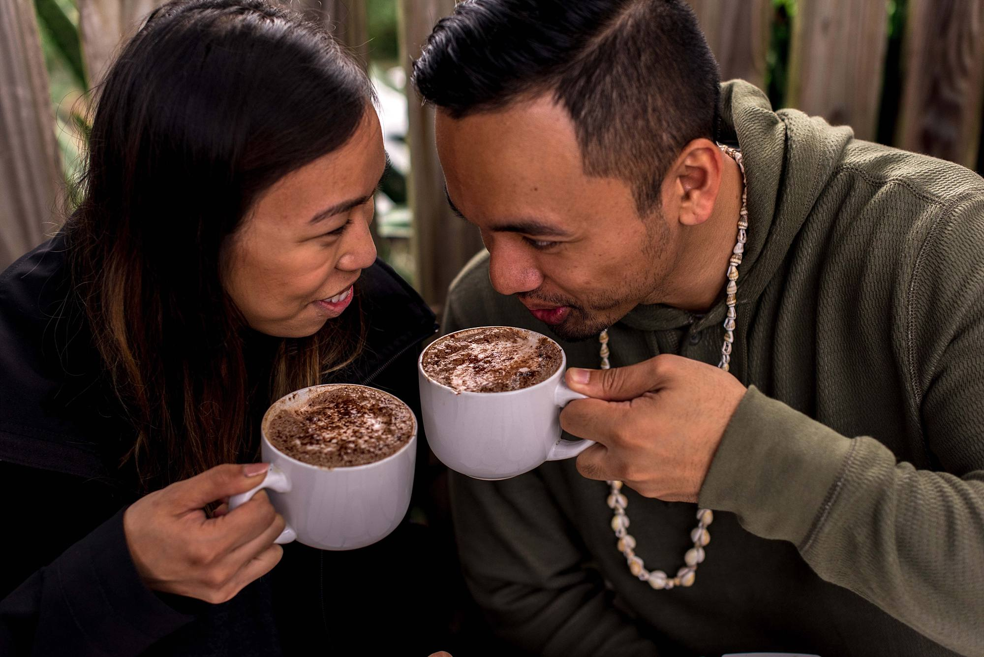 couple canoodling over coffee