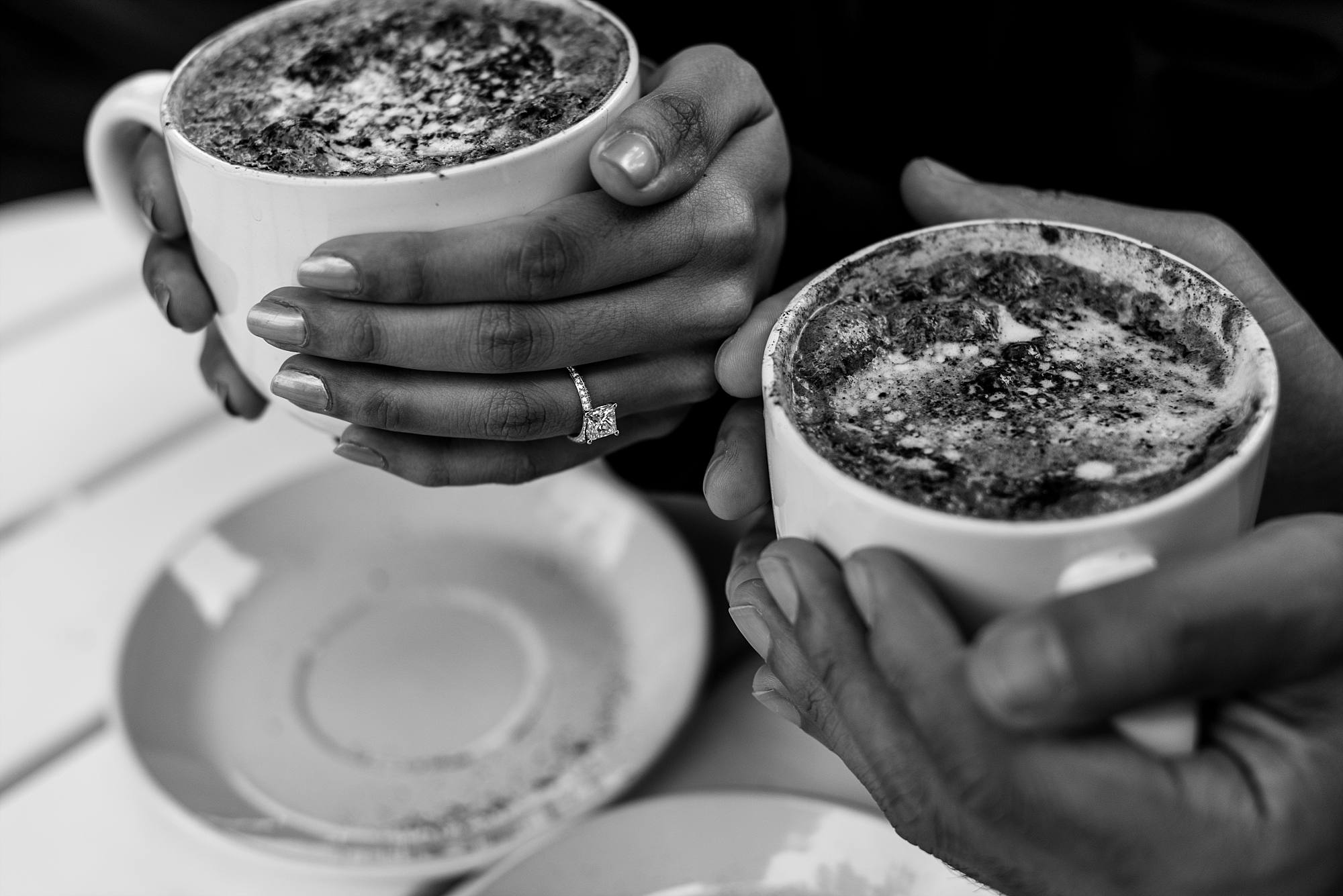 hands holding coffees