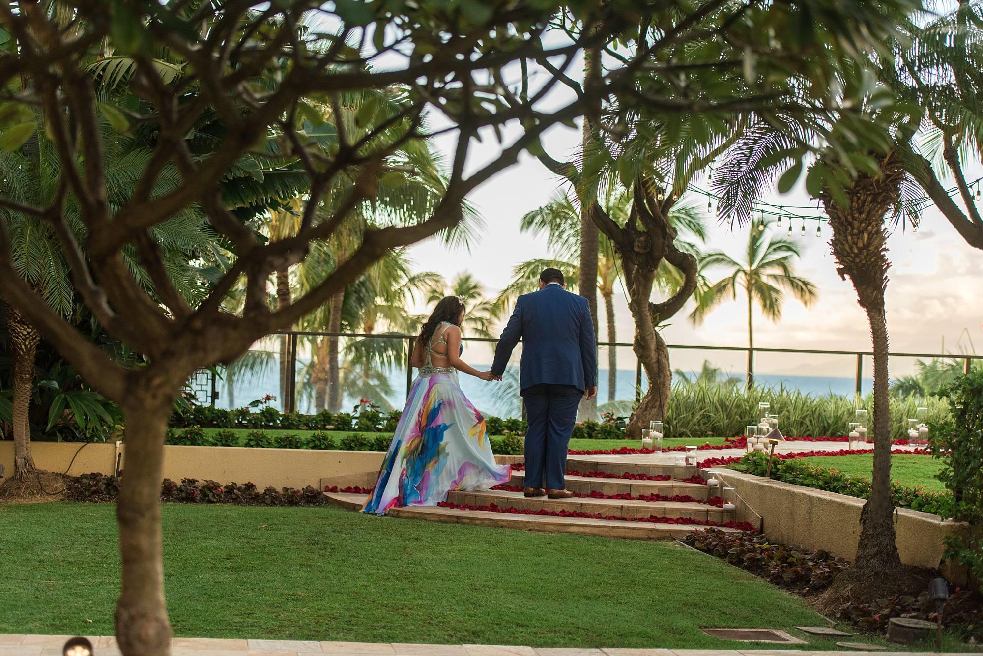 man leading girlfriend up the stairs overlooking ocean