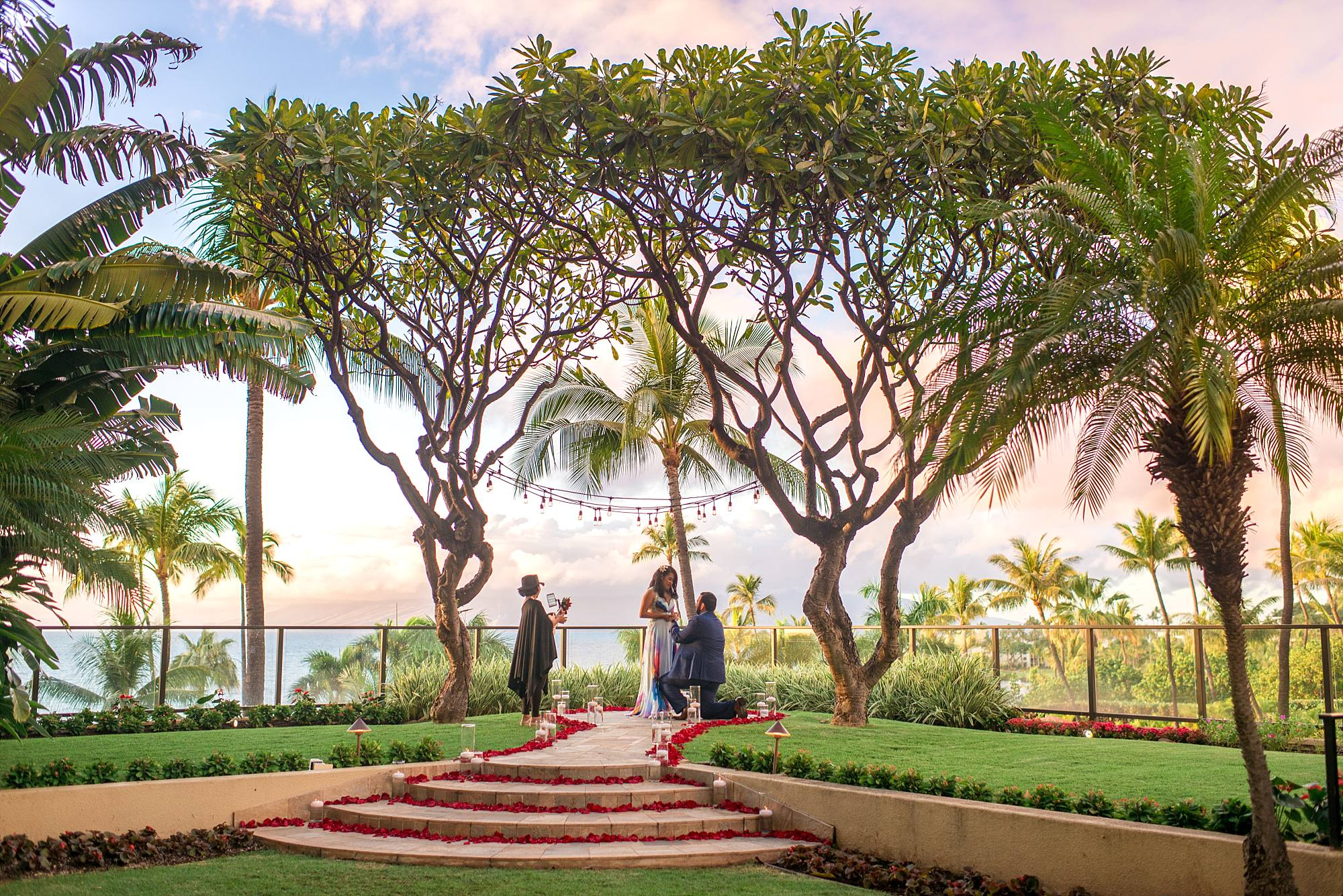 man proposing to woman atop beautiful staircase at the Four Seasons Maui