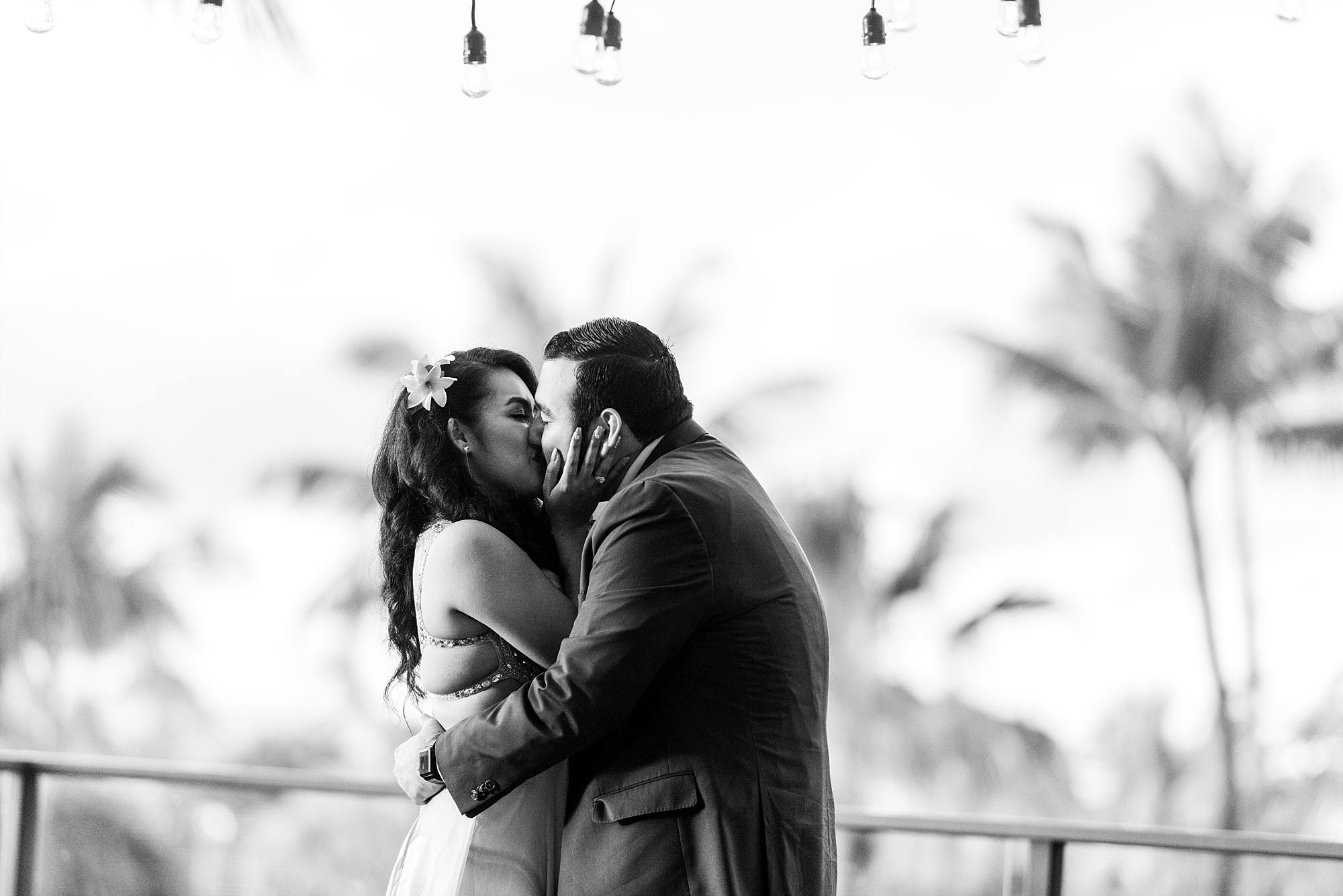 couple kissing right after their engagement