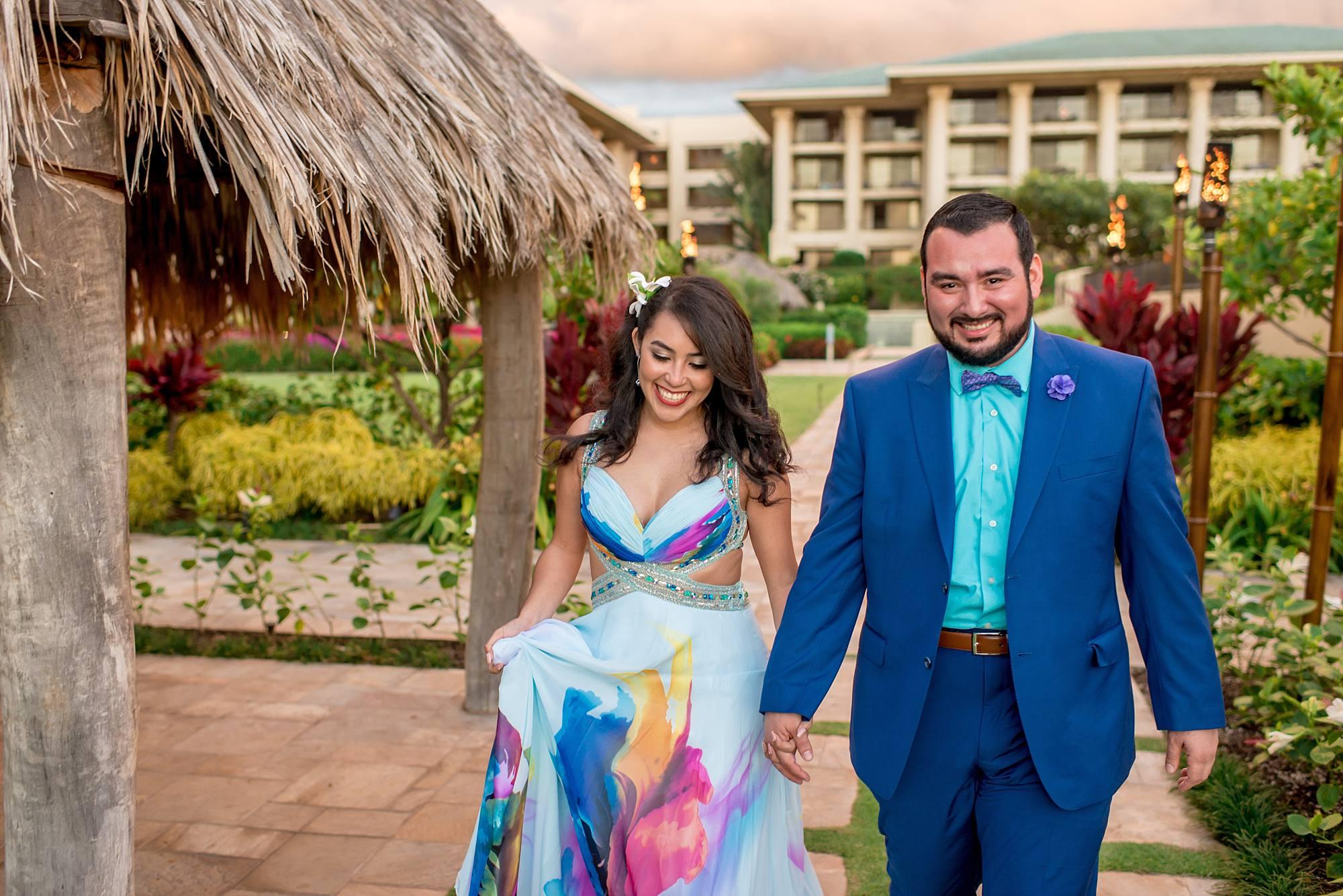 new fiances holding hands walking toward camera