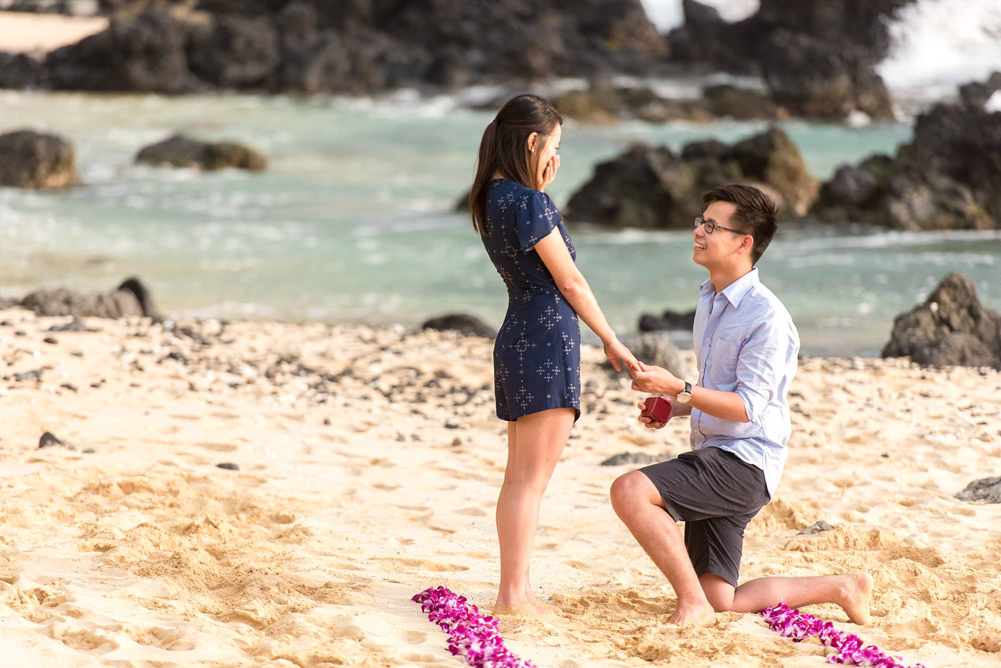 Man down on one knee proposing on South Maui beach