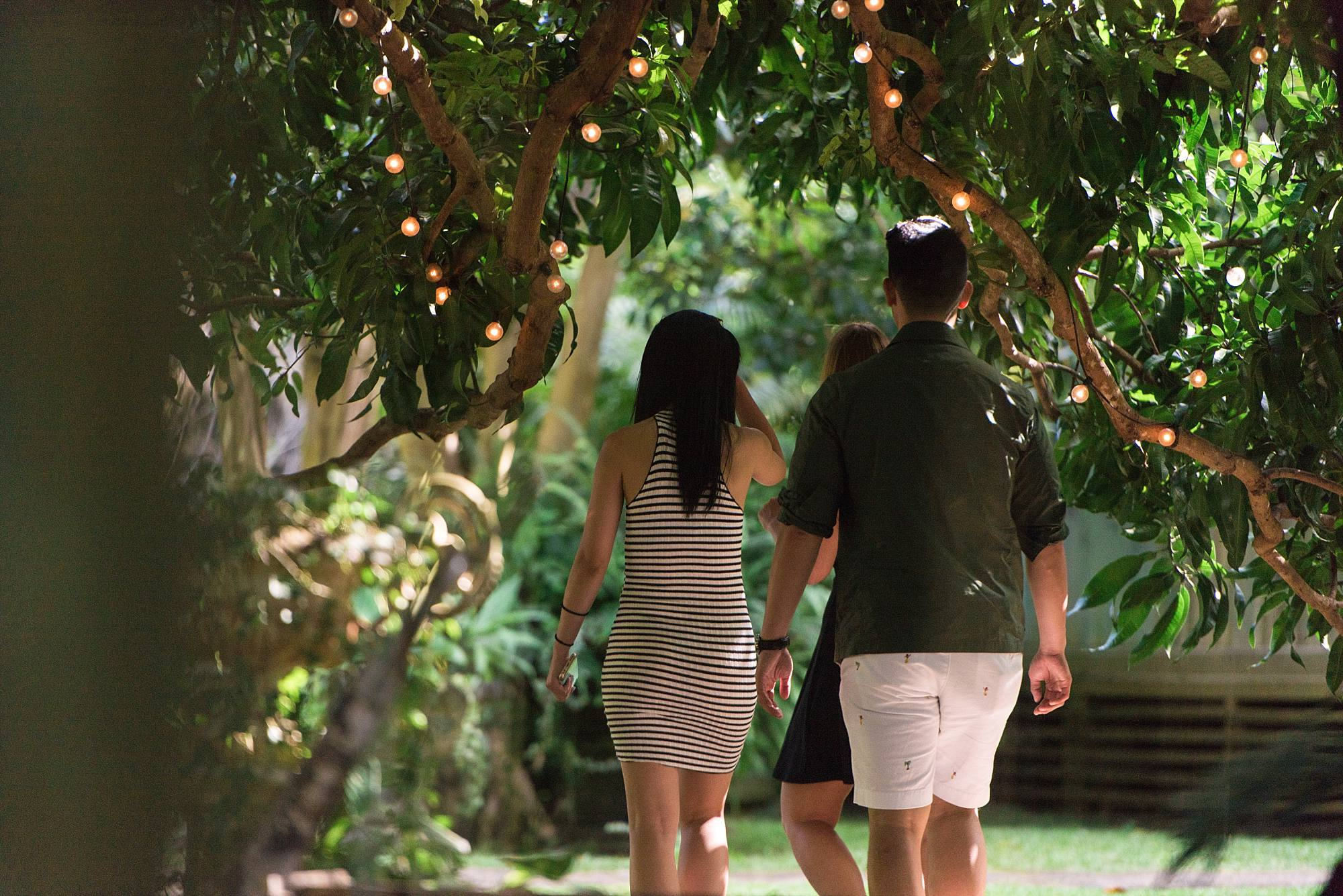 a couple walking through Haiku Mill archway
