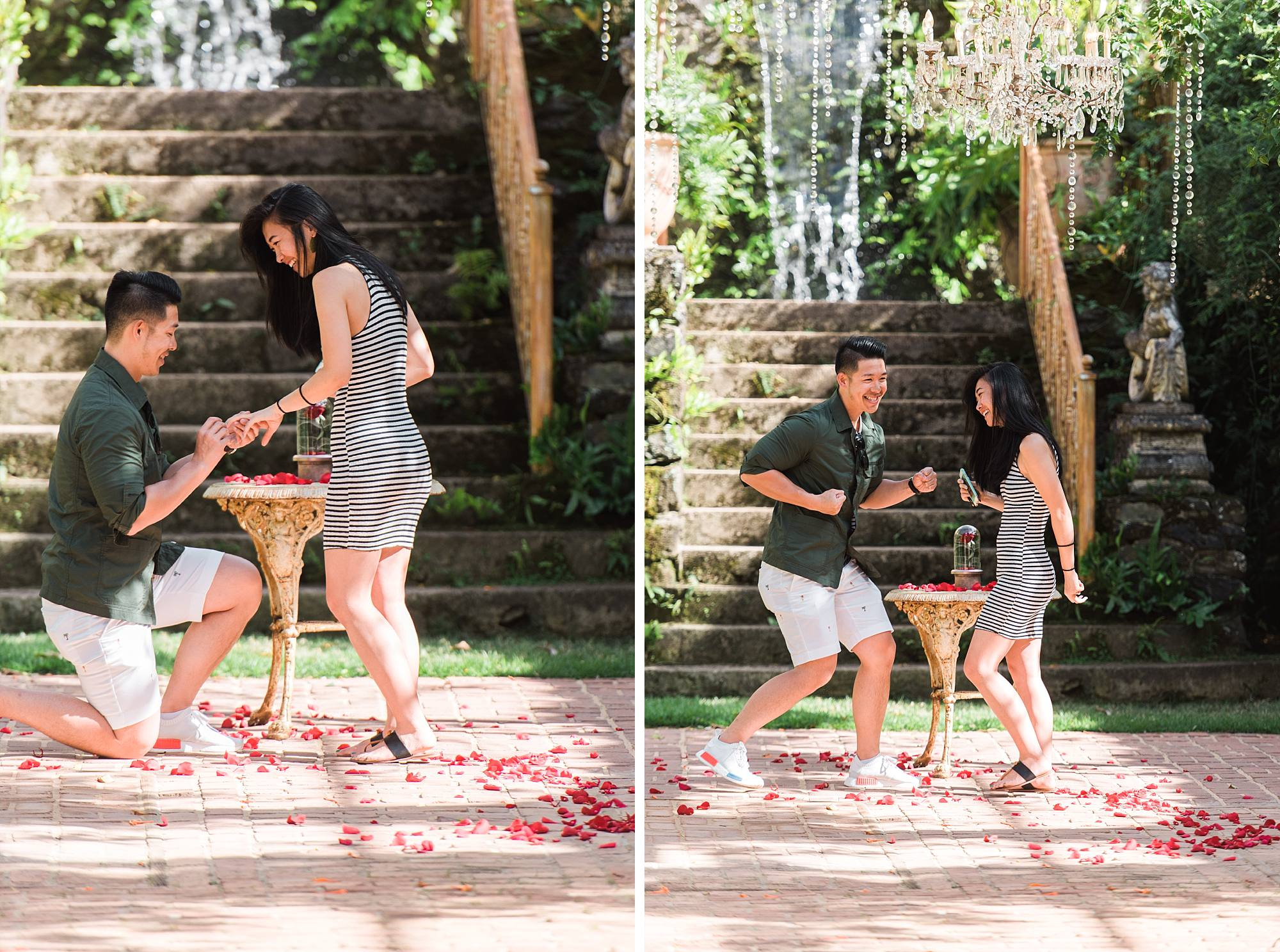 She said yes! He is putting a ring on her finger and doing a happy dance.