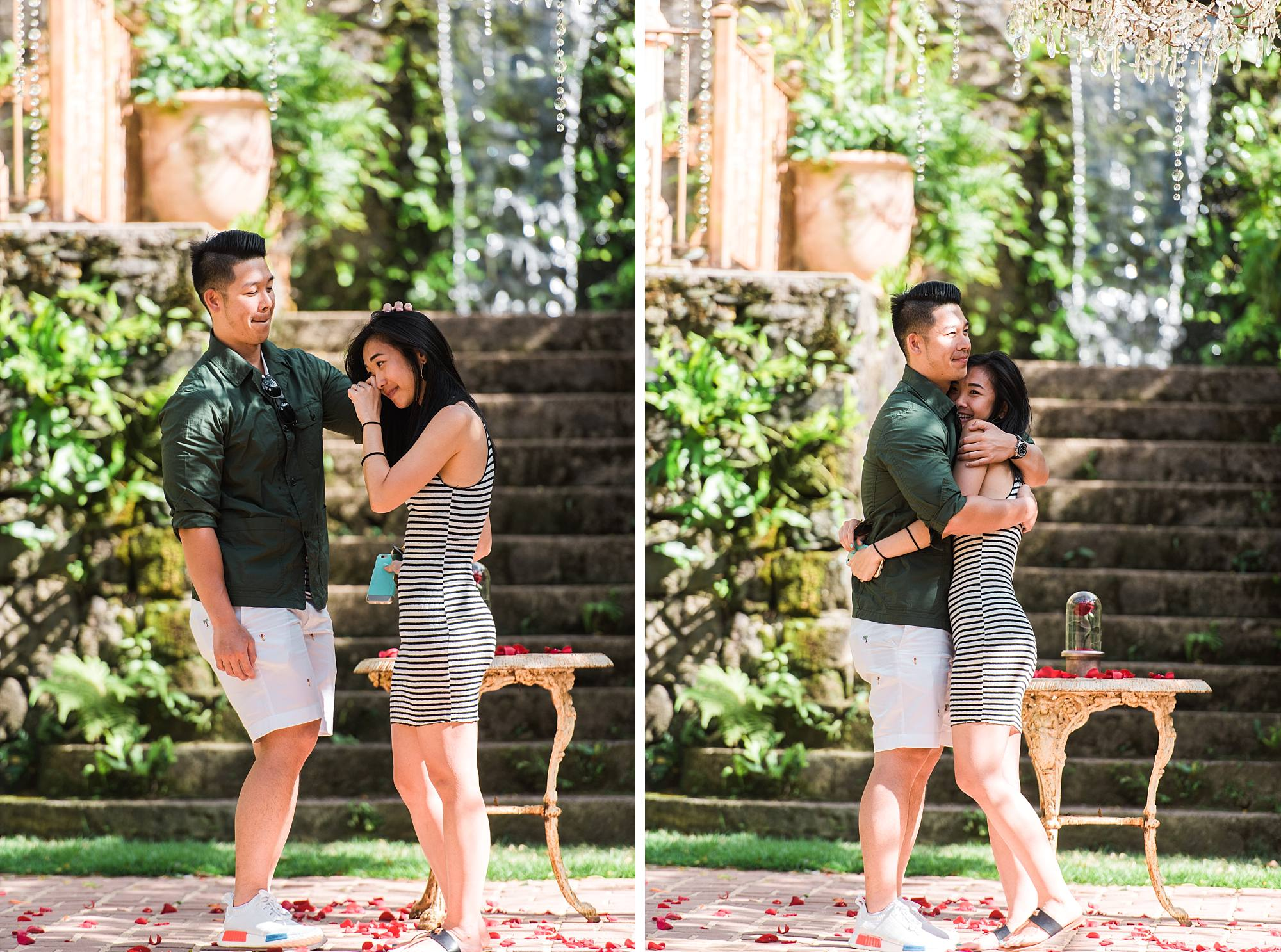 couple hugging in disbelief and excitement to finally be engaged. Beautiful stone stairs and plants are surrounding them at Haiku Mill.