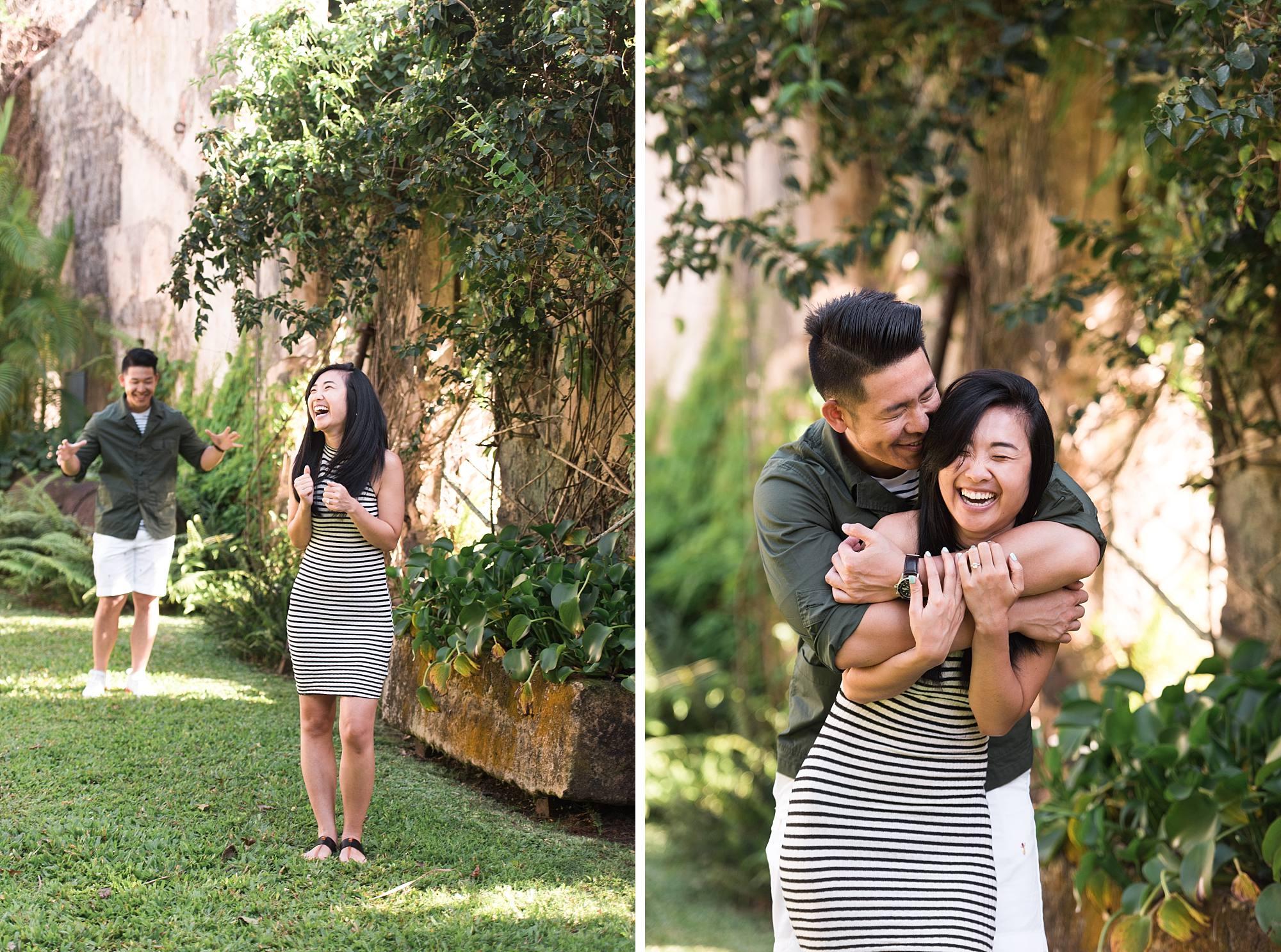 Man coming up to hug his new fiance in a ninja style hug